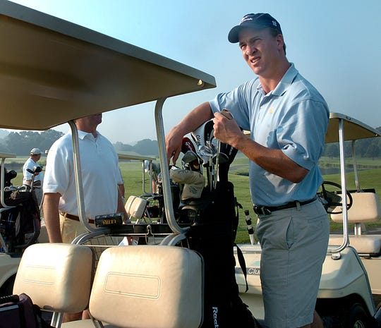 Peyton Manning hosted his St. Mary's Hospital Charity Golf Tournament at Eqwani Farms Golf Course Thursday. Peyton stood on the 8th tee and hit a fifth ball for each foursome in the morning round which they were allowed to use if they wanted. 6/23/2005