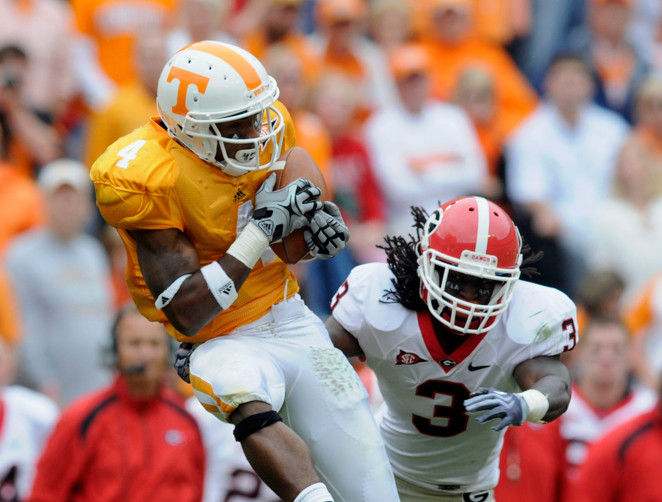 Tennessee wide receiver Gerald Jones (4) catches a pass ahead of Georgia safety Bryan Evans (3) for a 33-yard gain during their game  on Saturday, Oct. 10, 2009 at Neyland Stadium.