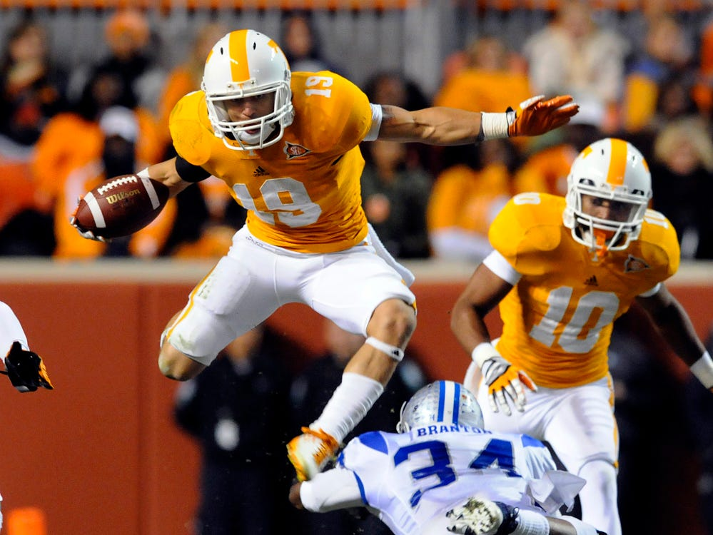 Tennessee running back Devrin Young (19) leaps over MTSU's Marquise Branton (34) during the first half against Saturday, Nov. 5, 2011 in Neyland Stadium.