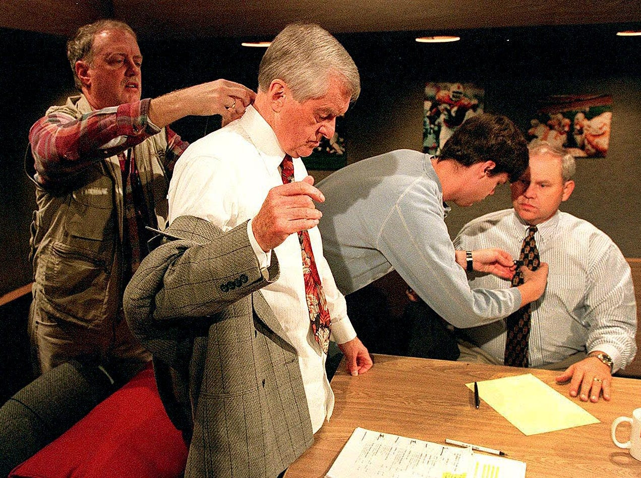 John Ward reads his notes as the crew prepares his and Fulmer's microphones. A big part of Ward's job is the weekly Sunday morning Phil Fulmer Show Nov. 21, 1998.