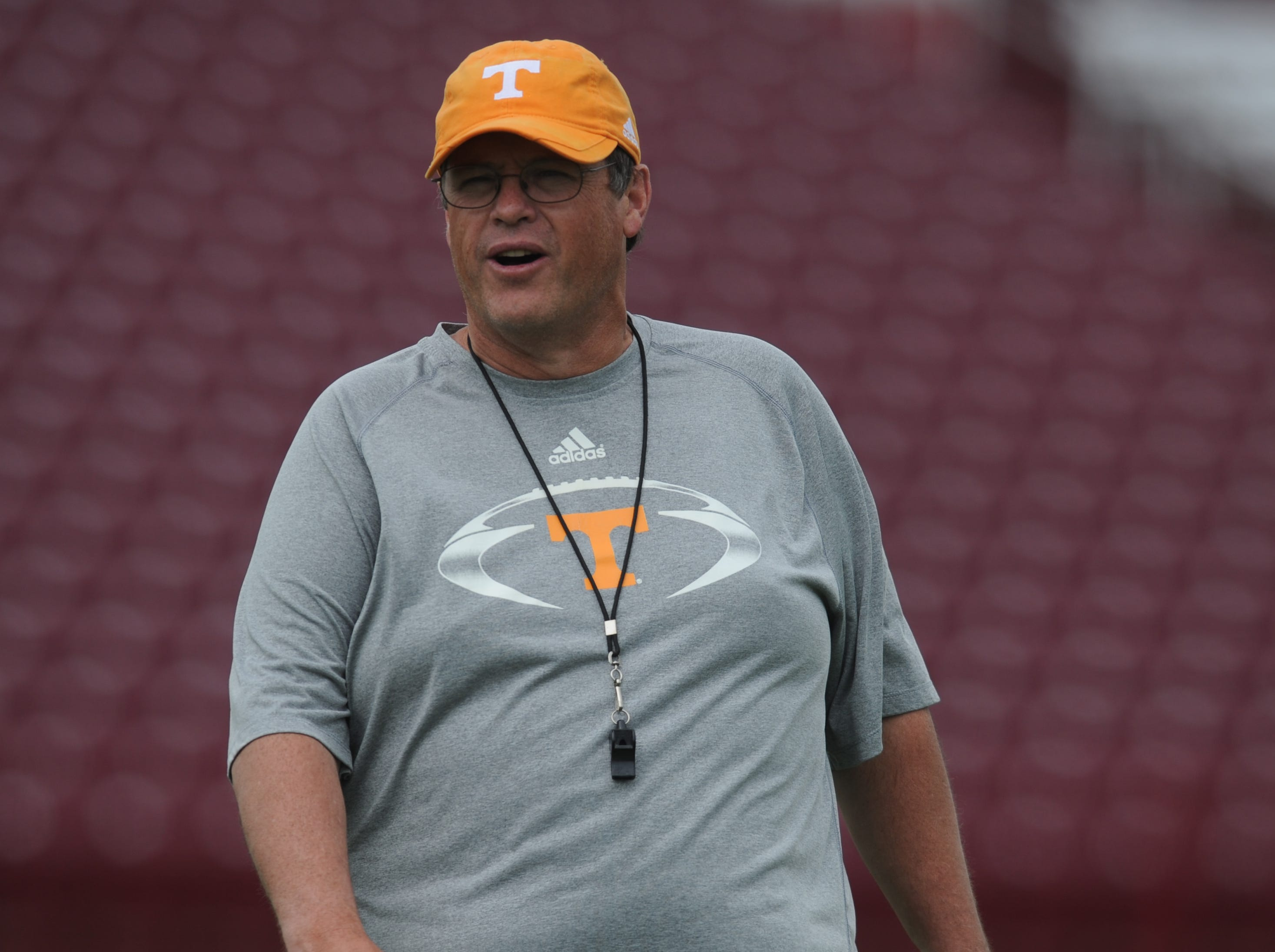 Tennessee offensive coordinator Jim Chaney calls to his players during practice at Science Hill High School's Steve Spurrier Field in Kermit Tipton Stadium in Johnson City, Tenn., Friday, Aug. 10, 2012.