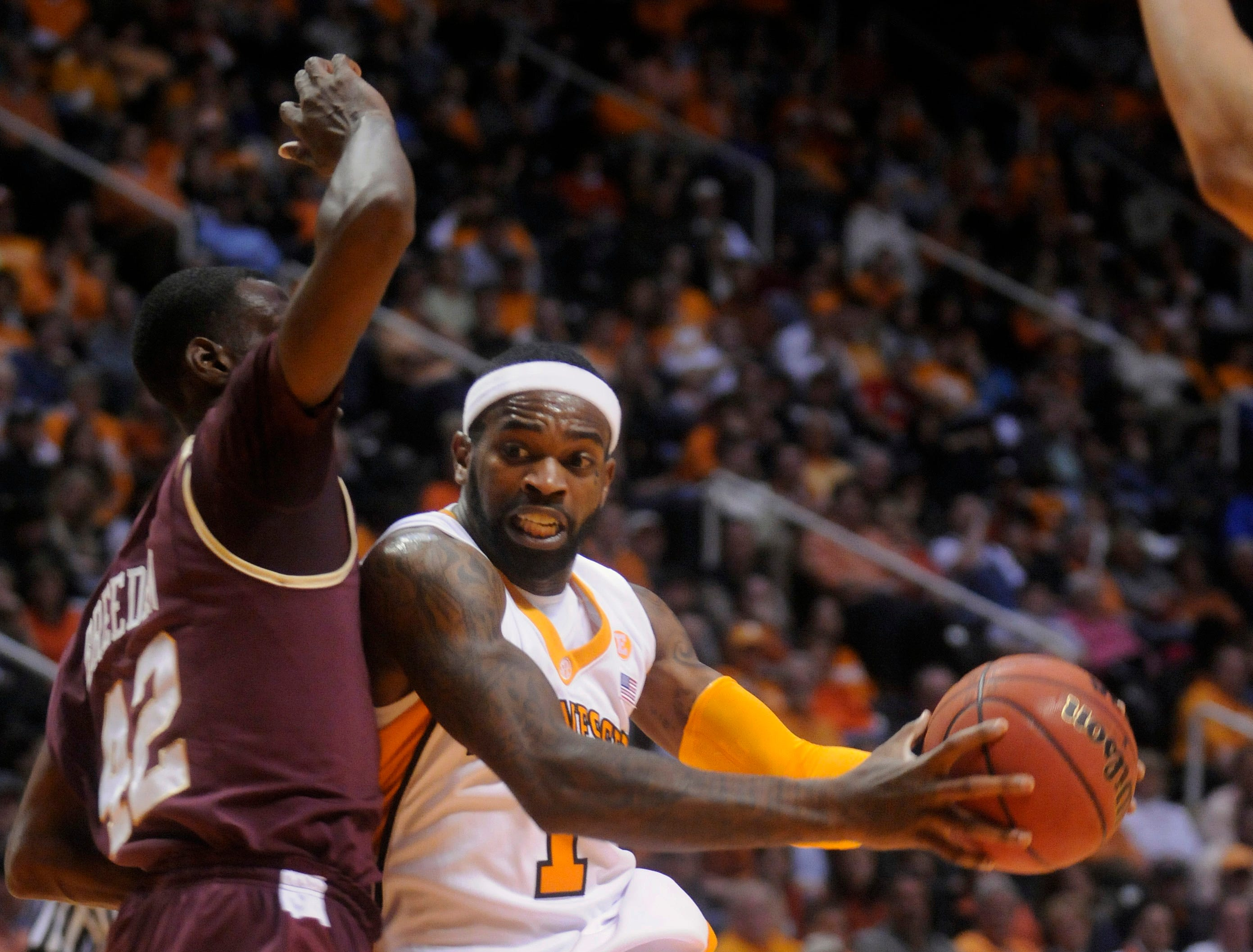 Tennessee guard Tyler Smith (1) works around College of Charleston forward Casaan Breeden (42) in the second half of an NCAA college basketball game in Knoxville, Tenn., Friday., Nov.  27, 2009.