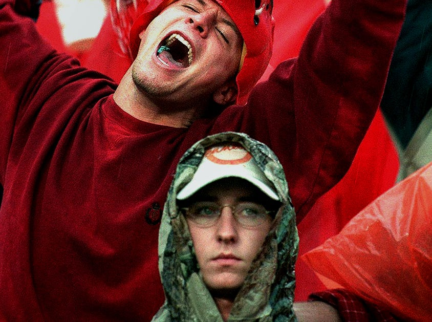 Reagan Russell, from Fayetteville, Ark, celebrates after the Razorbacks score early in the game Saturday 1998. The game later turned and Tennessee won.