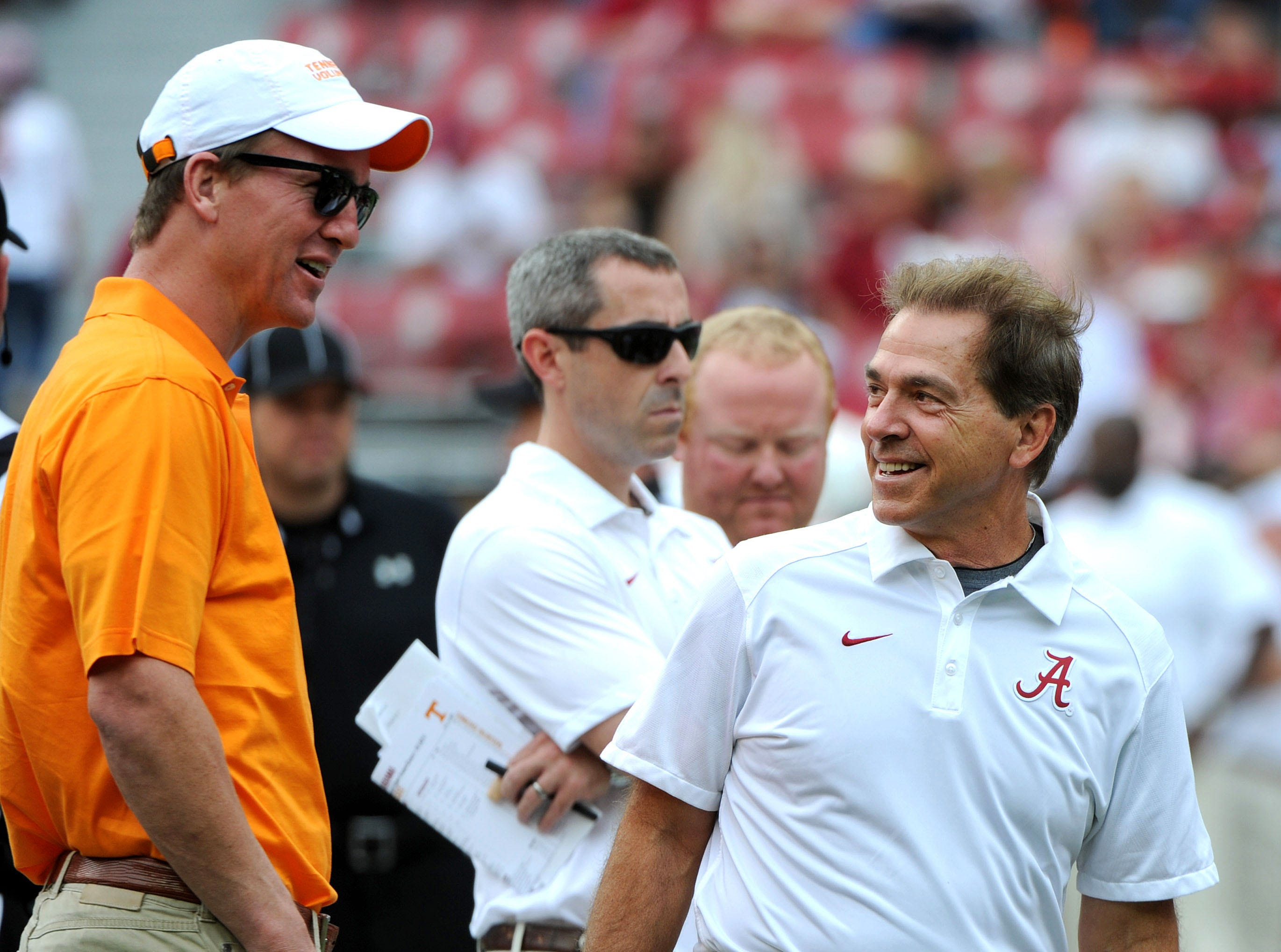 Alabama head coach Nick Saban and Peyton Manning chat midfield before the Tennessee's game against Alabama at Bryant-Denny Stadium in Tuscaloosa, Ala. Saturday, Oct. 24, 2015.