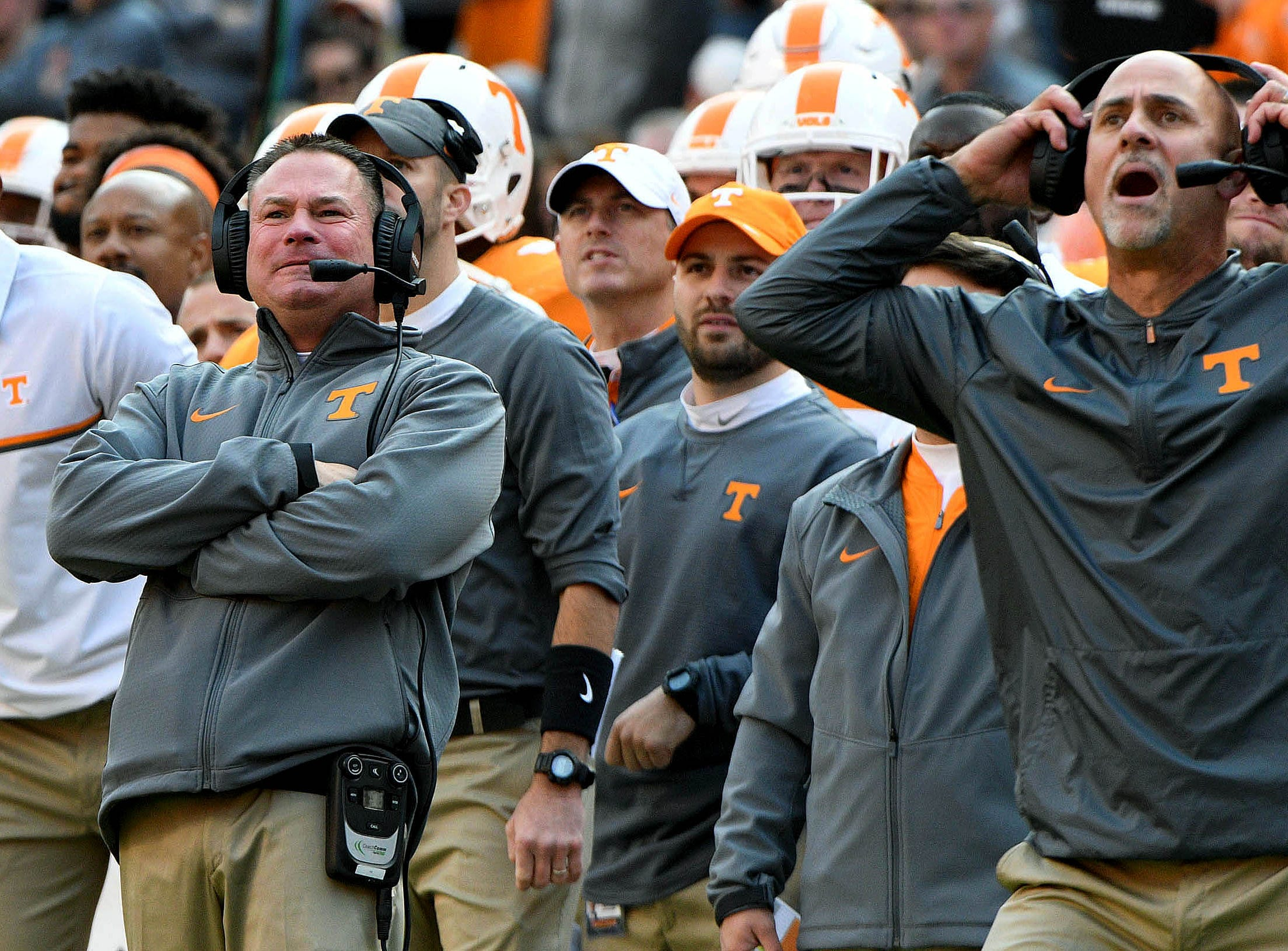 Tennessee head coach Butch Jones and coach Willie Martinez, right, both react as an extra point kick flies through the air during the second half at Neyland Stadium on Saturday, Nov. 12, 2016.