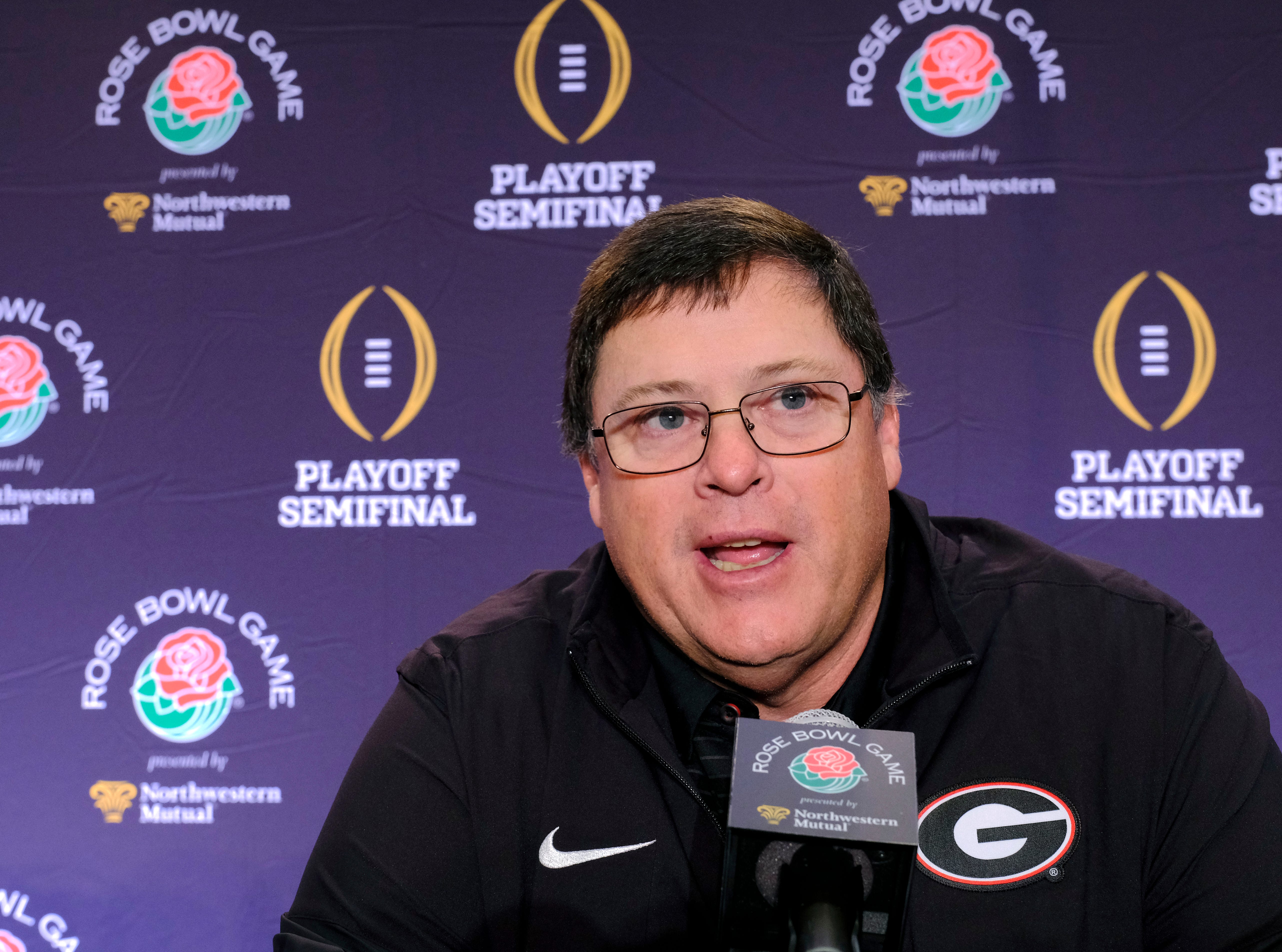 Georgia offensive coordinator Jim Chaney talks to reporters during a news conference in Los Angeles on Thursday, Dec. 28, 2017. Oklahoma will take on Georgia on Monday, Jan. 1, 2018.