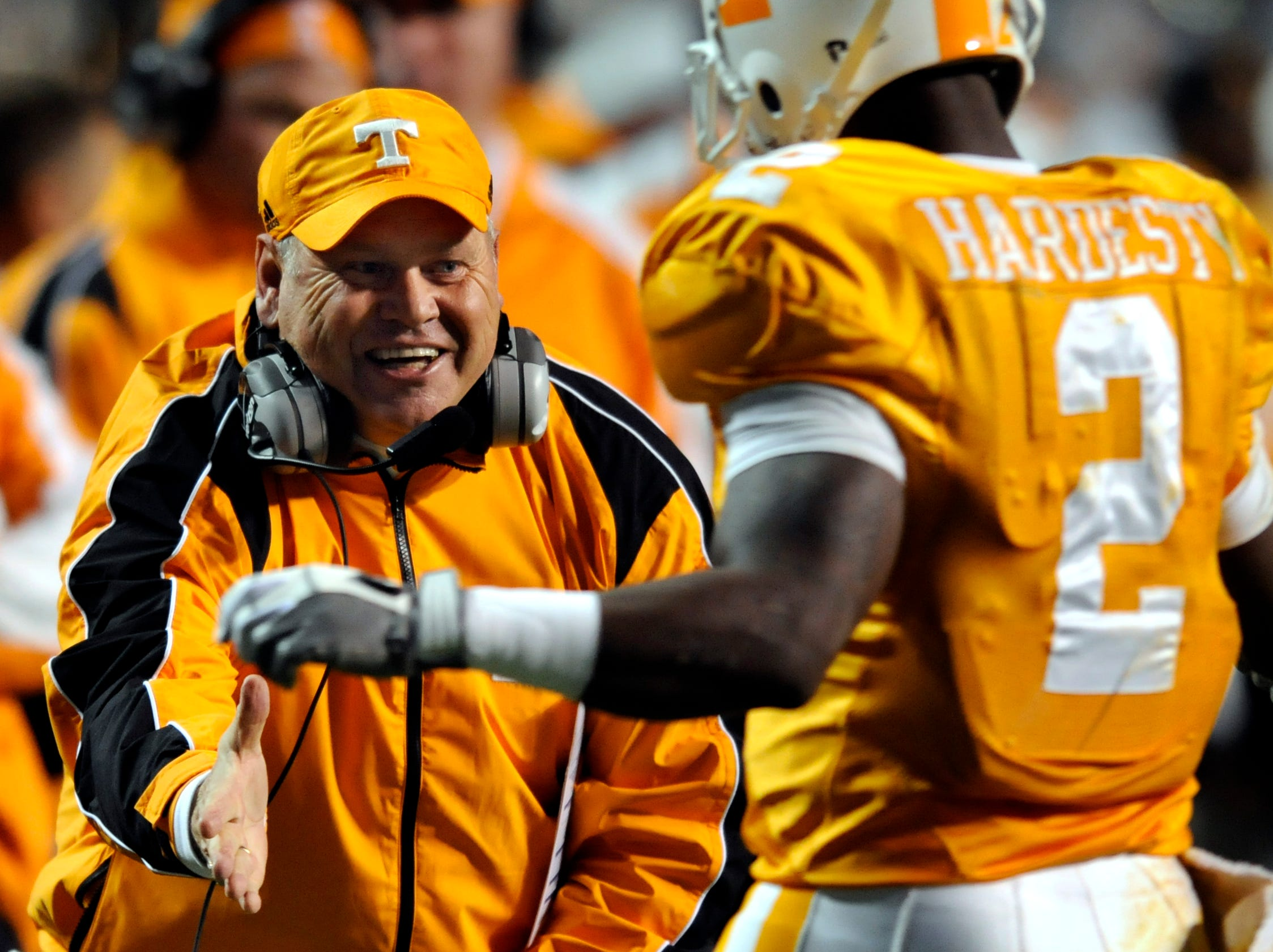 Tennessee head coach Phillip Fulmer congratulates running back Montario Hardesty (2) as he comes off the field after scoring one of Tennessee's touchdowns in their 28-10 victory over Kentucky Saturday in Neyland Stadium in Knoxville.