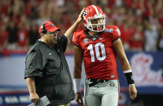 Sep 3, 2016; Atlanta, GA, USA; Georgia Bulldogs offensive cordinator Jim Chaney talks with quarterback Jacob Eason (10) on the sideline during the third quarter of the 2016 Chick-Fil-A Kickoff game against the North Carolina Tar Heels at Georgia Dome.