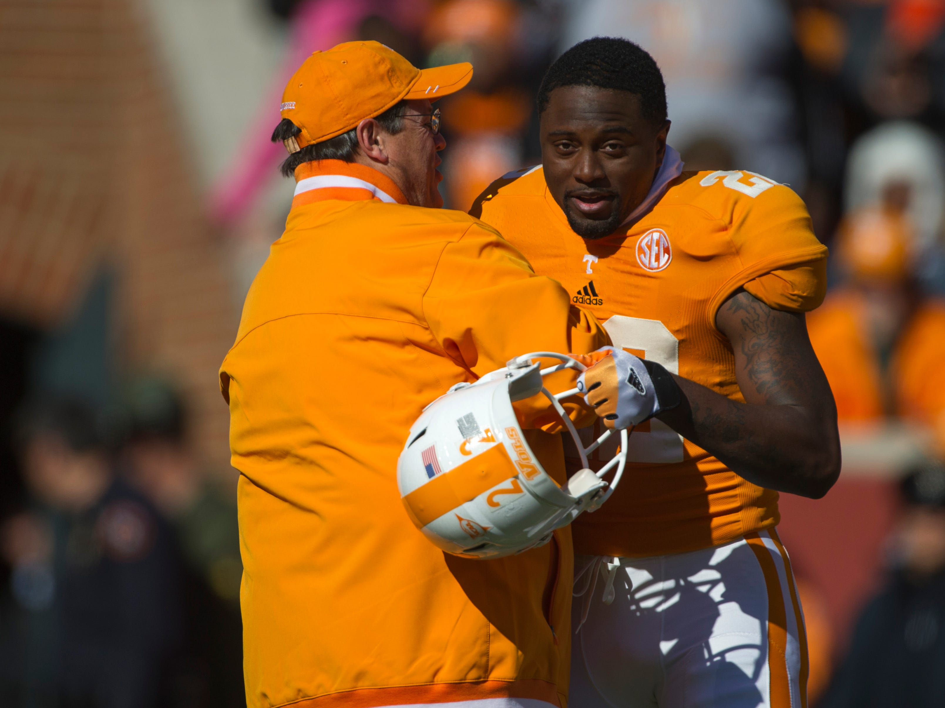 "Tennessee defensive back Rod Wilks (22) is congratulated by interim head coach Jim Chaney as he runs through the ""T"" one last time before the game against Kentucky at Neyland Stadium Saturday, Nov. 24, 2012."