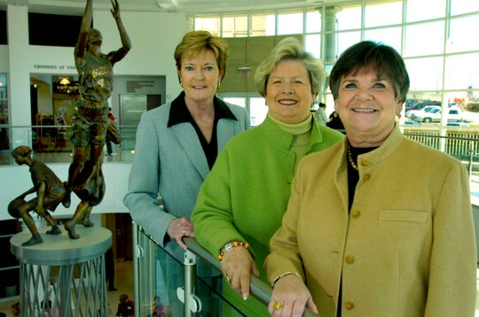 Left to right are Pat Summitt, Lady Vols basketball coach, Joan Cronan, UT athletic department, and Gloria Ray, Tourism and Sports Corp. Photograph taken inside the Women's Basketball Hall of Fame.