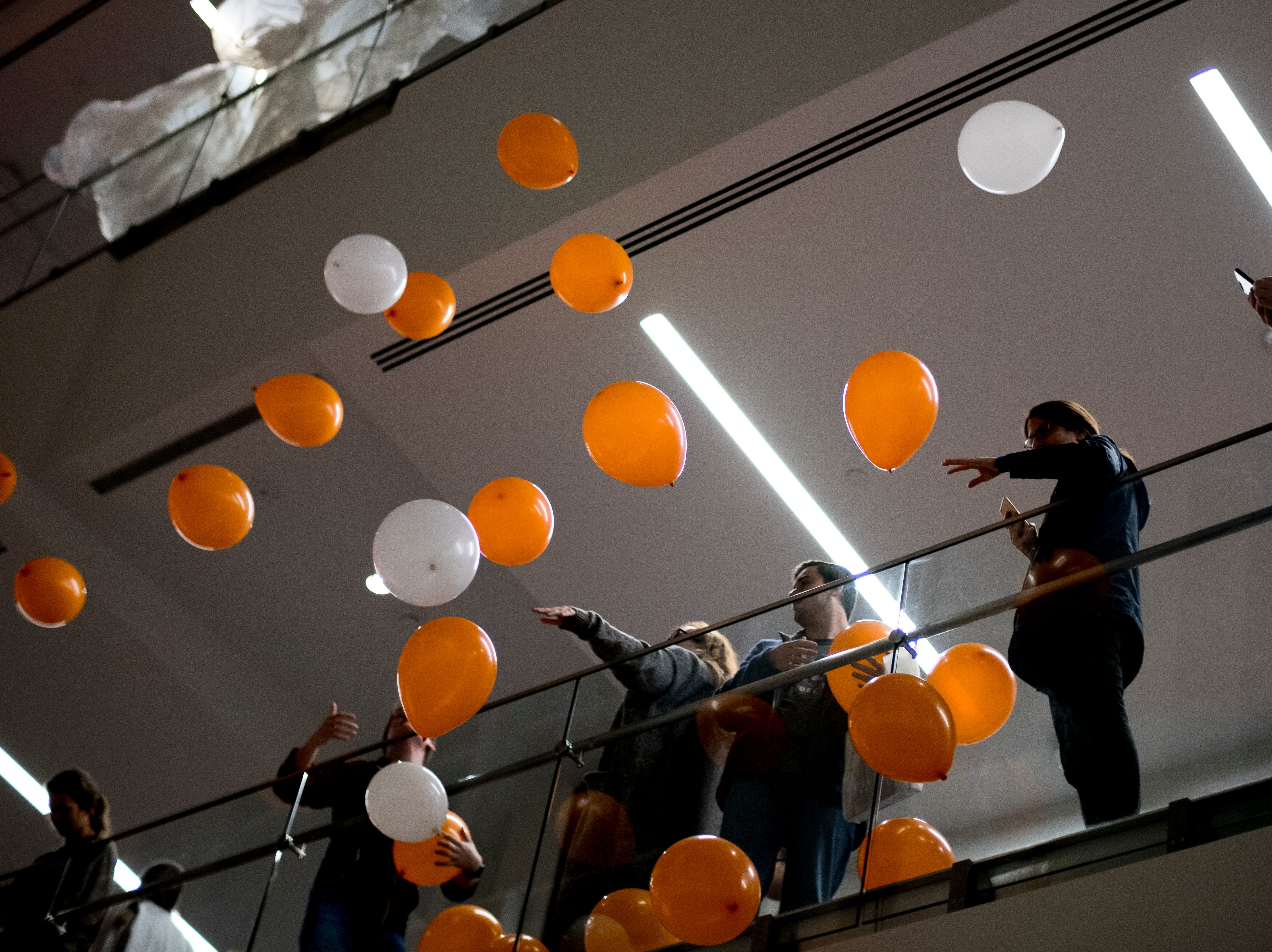 "Balloons are dropped from the third floor after the torch was lit during a lighting of the torchbearer celebration at the new UT Student Union in Knoxville, Tennessee on Tuesday, January 8, 2019. The blown glass ""flames"" were created by Knoxville expert glass blower Matthew Cummings of Pretentious Glass Co."