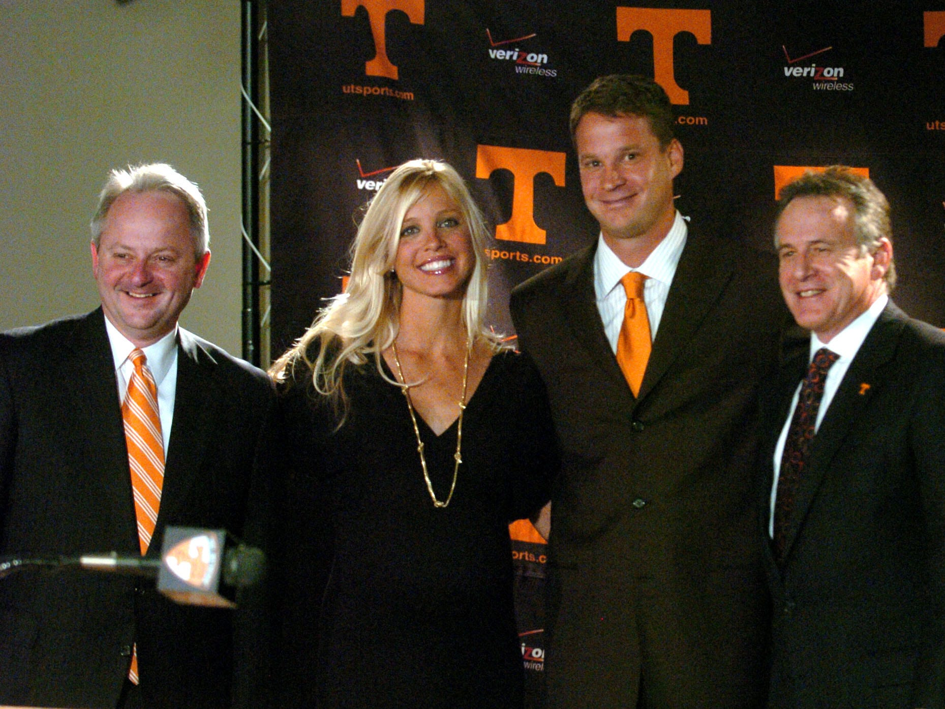 Athletic Director Mike Hamilton, left, new football coach Lane Kiffin with his wife, Layla, and UT President John Petersen pose for photographers after a press conference at Neyland Stadium Dec. 1, 2008. Kiffin stayed only 13 months before resigning to take the head job at Southern California.