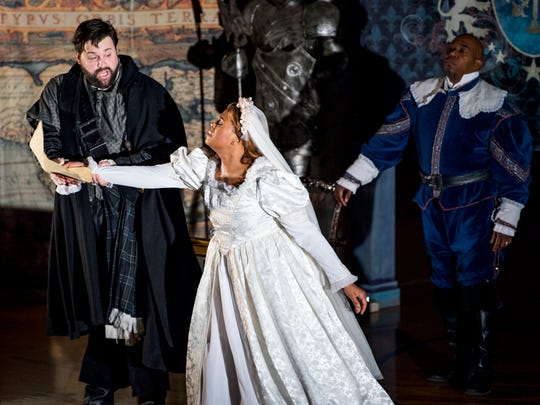 Tenor Brandon Russell, left, and soprano Brittany Robinson, center, perform as Lucia and Edgardo as baritone Eric McKeever, right, performs as Enrico in Donizetti's 1835 opera Lucia di Lammermoor at Farragut Middle School's gym on Wednesday, January 9, 2019. Robinson, Russell and McKeever performed as part of Knoxville Opera, which brings an abridged version of the opera to East Tennessee schools.