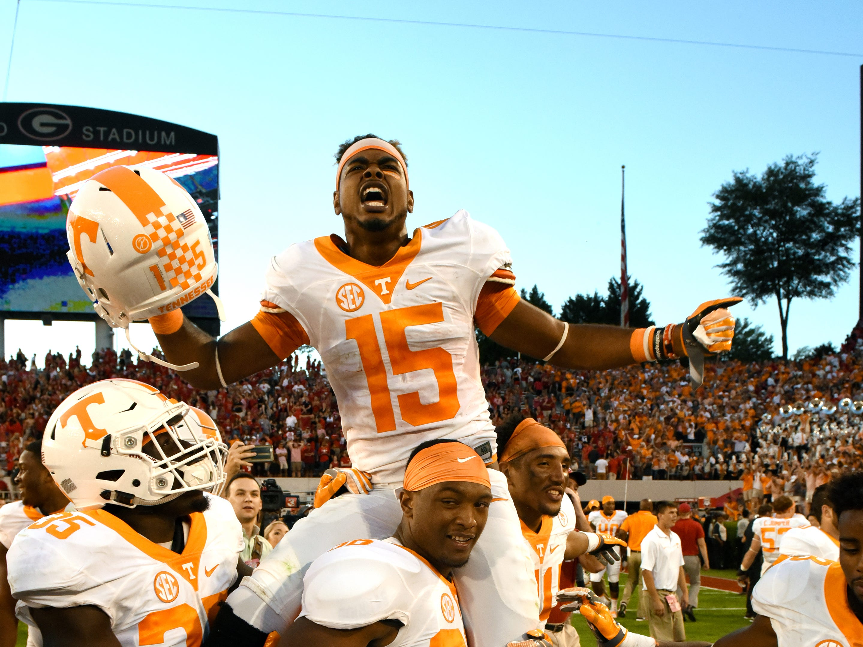 Tennessee wide receiver Jauan Jennings (15) is carried off the field by linebacker Gavin Bryant (36) following their 34-31 win over Georgia at Sanford Stadium Saturday, Oct. 1, 2016 in Athens, Ga.