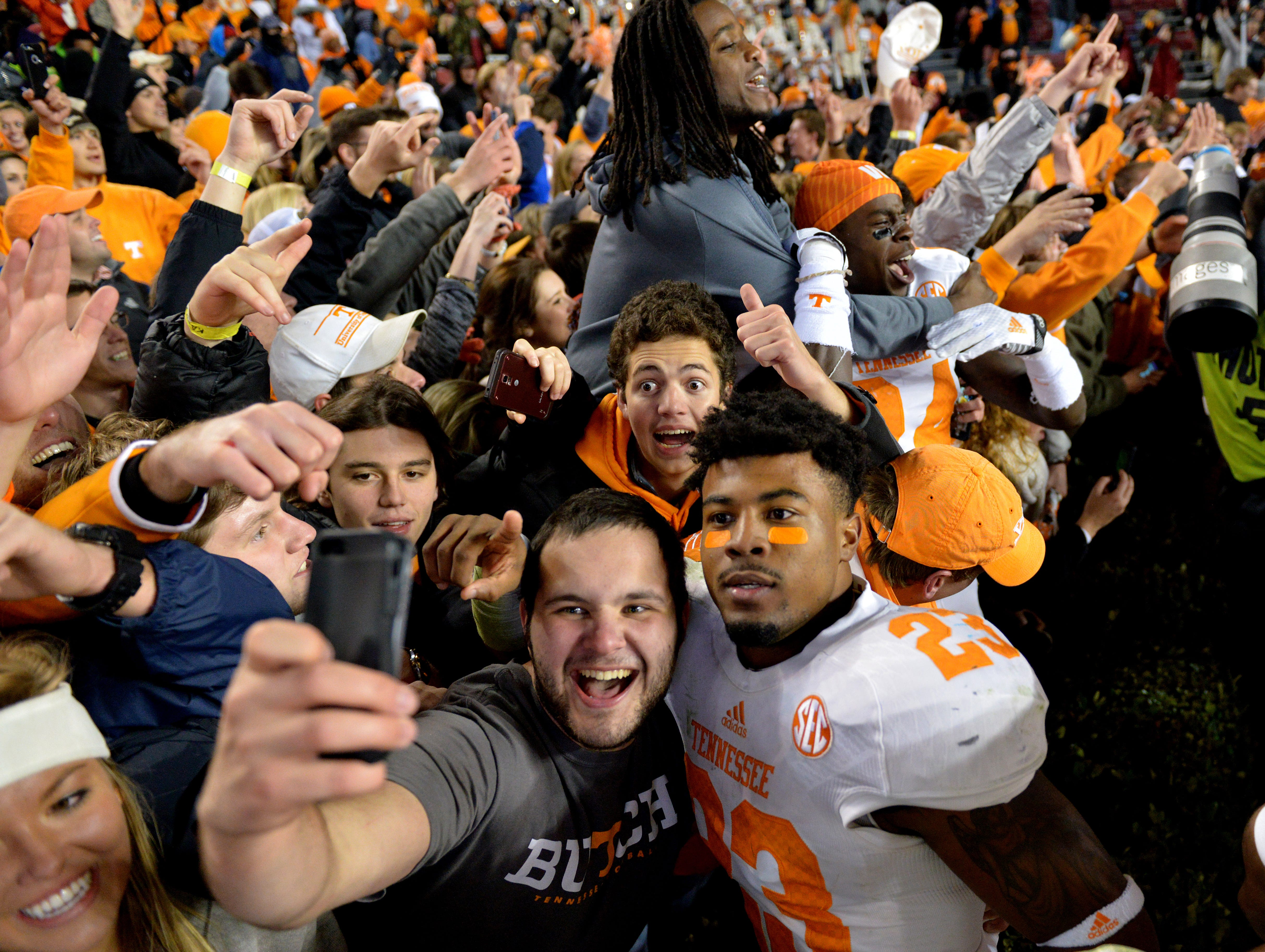 Tennessee defensive back Cameron Sutton (23) celebrates with fans following their 45-42 win in overtime against South Carolina in Williams-Brice Stadium Saturday, Nov. 1, 2014 in Columbia, S.C.