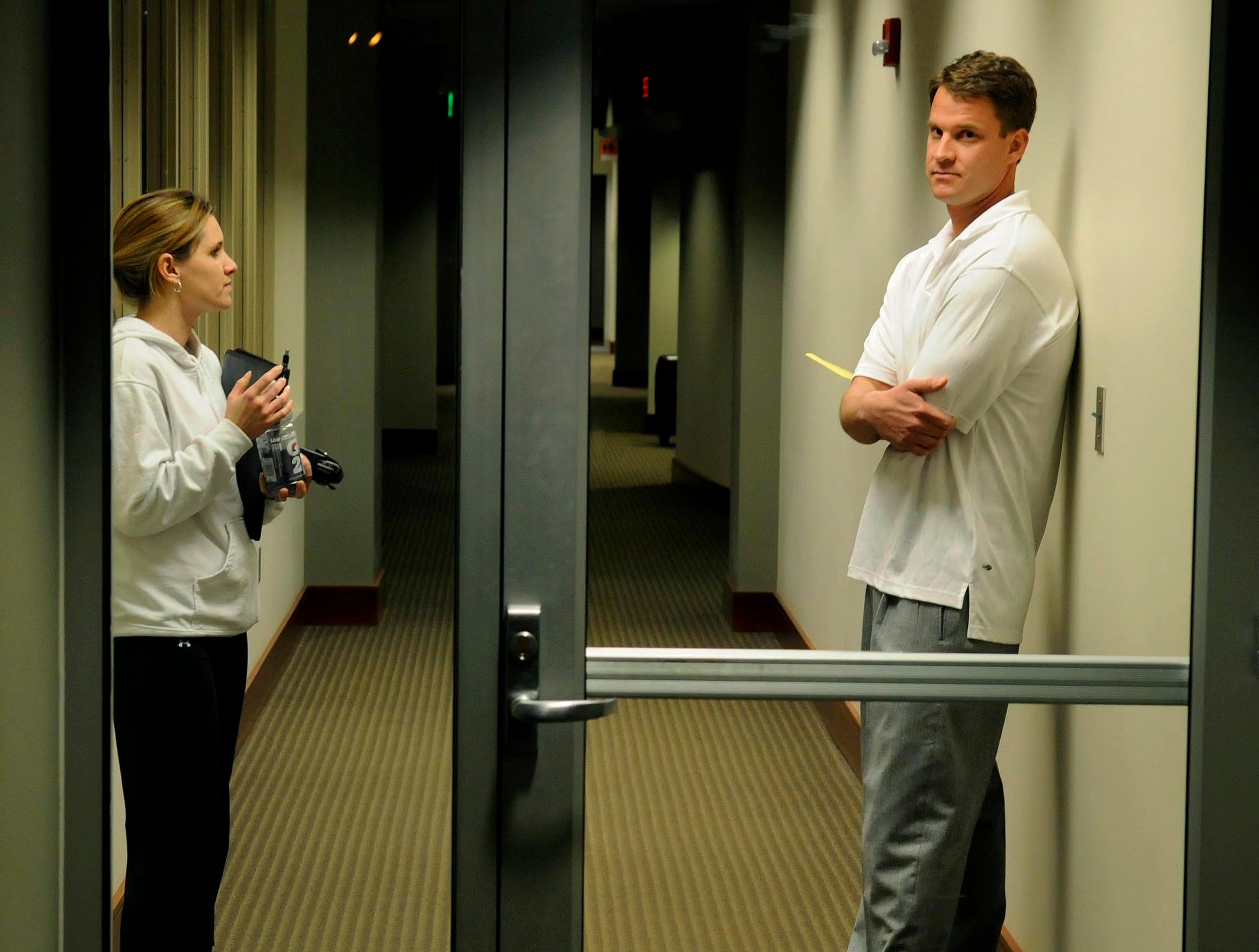 Lane Kiffin in the hallway Tuesday, Jan 12, 2010 waiting for television stations to kill their live feed before he would start  his press conference about leaving Tennessee.