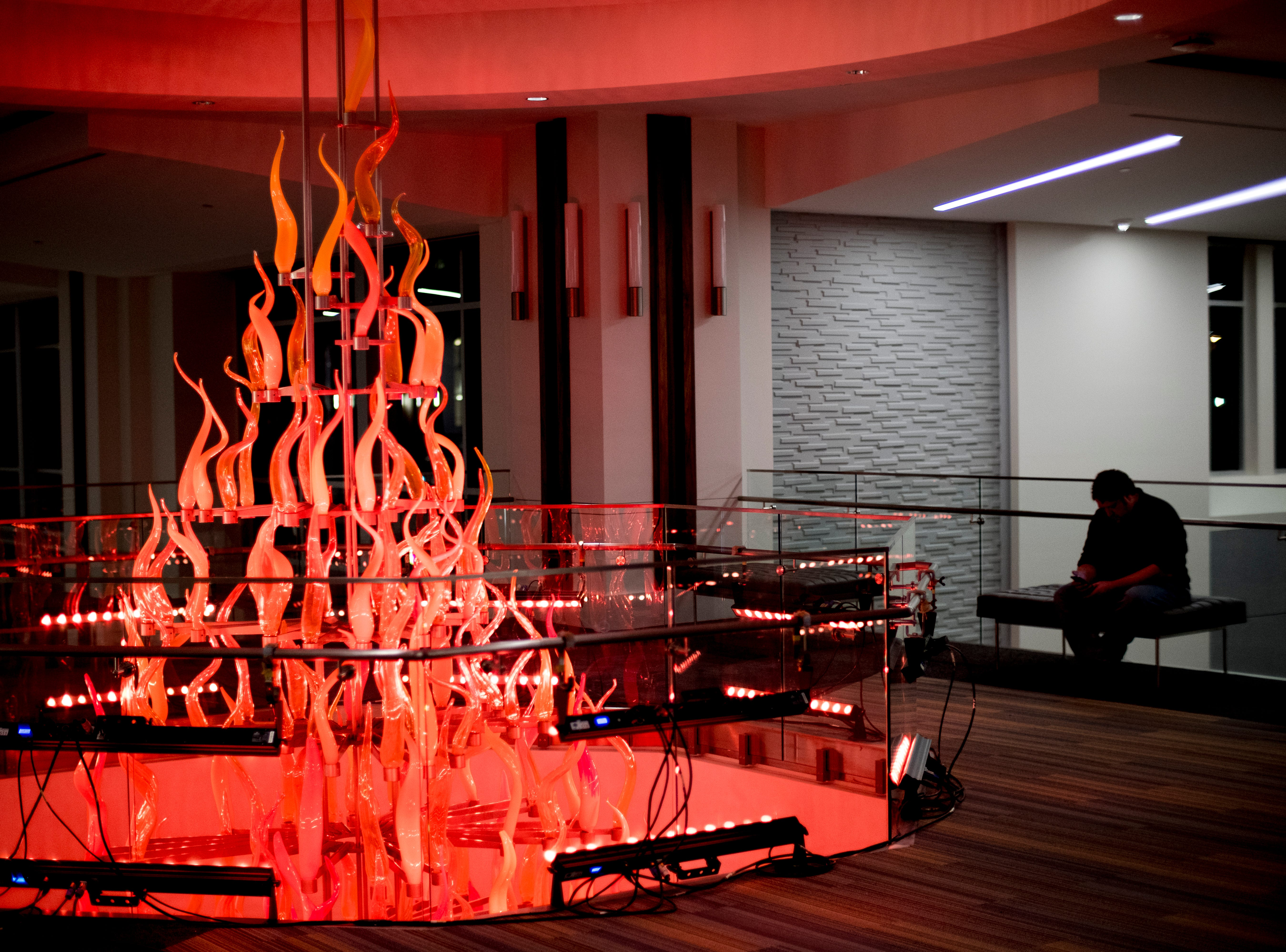 "The top of the torch reaches the third floor during a lighting of the torchbearer celebration at the new UT Student Union in Knoxville, Tennessee on Tuesday, January 8, 2019. The blown glass ""flames"" were created by Knoxville expert glass blower Matthew Cummings of Pretentious Glass Co."