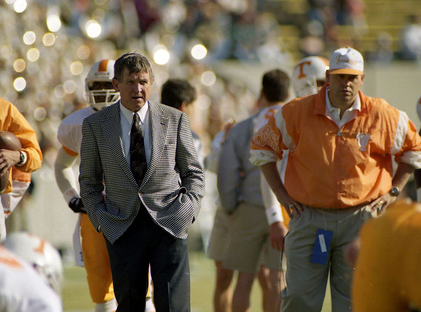 Tennessee head coach Johnny Majors and offensive coordinator Phillip Fulmer watch the Vols warm up before the Memphis State game Saturday, Nov. 14, 1992