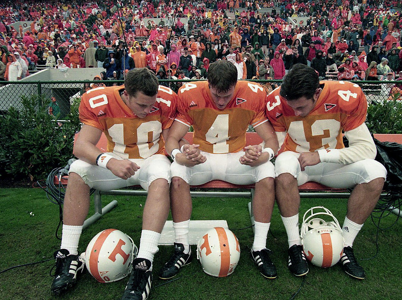 University of Tennessee kickers Benson Scott, left, Jeff Hall, center, and David Leaverton stop to pray after their warmups before their game Nov. 14, 1998.