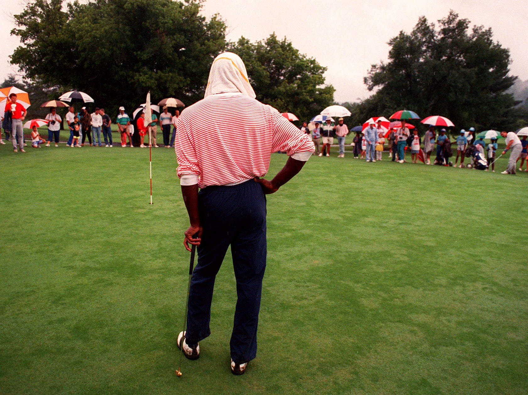 Despite a day of endless rain, Chicago Bulls star Michael Jordan shows he has thing covered during an exhibition round at Houston Hills. Jordan was scheduled to play in the D.D. Lewis golf tournament, but the event was postponed June 16, 1989.