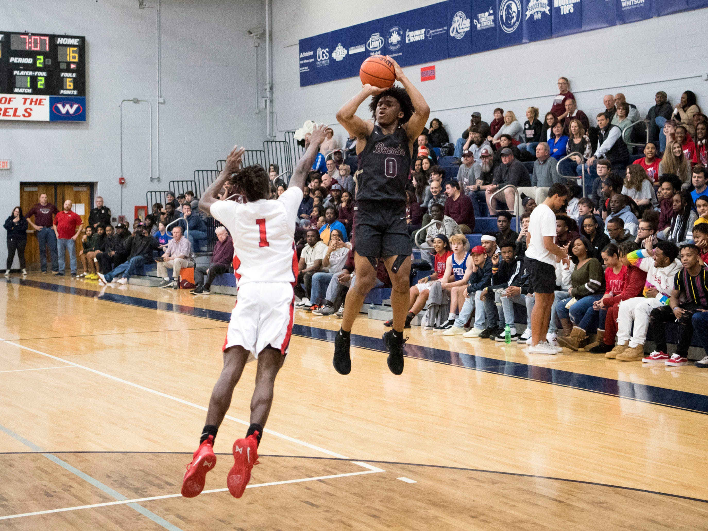 Bearden's Ques Glover (0) on a 3-point attempt while guarded by West's Michael Webb (1) on Tuesday, January 8, 2019.