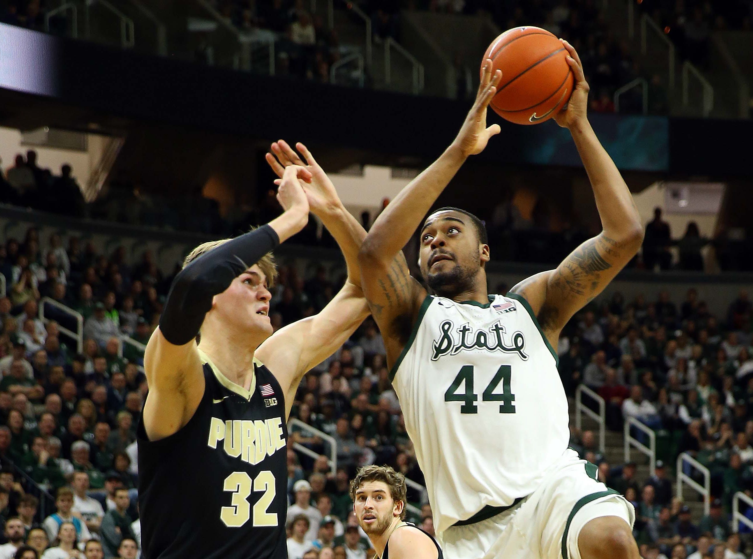 Jan 8, 2019; East Lansing, MI, USA; Michigan State Spartans forward Nick Ward (44) is defended by Purdue Boilermakers center Matt Haarms (32) during the second half of a game at the Breslin Center. Mandatory Credit: Mike Carter-USA TODAY Sports