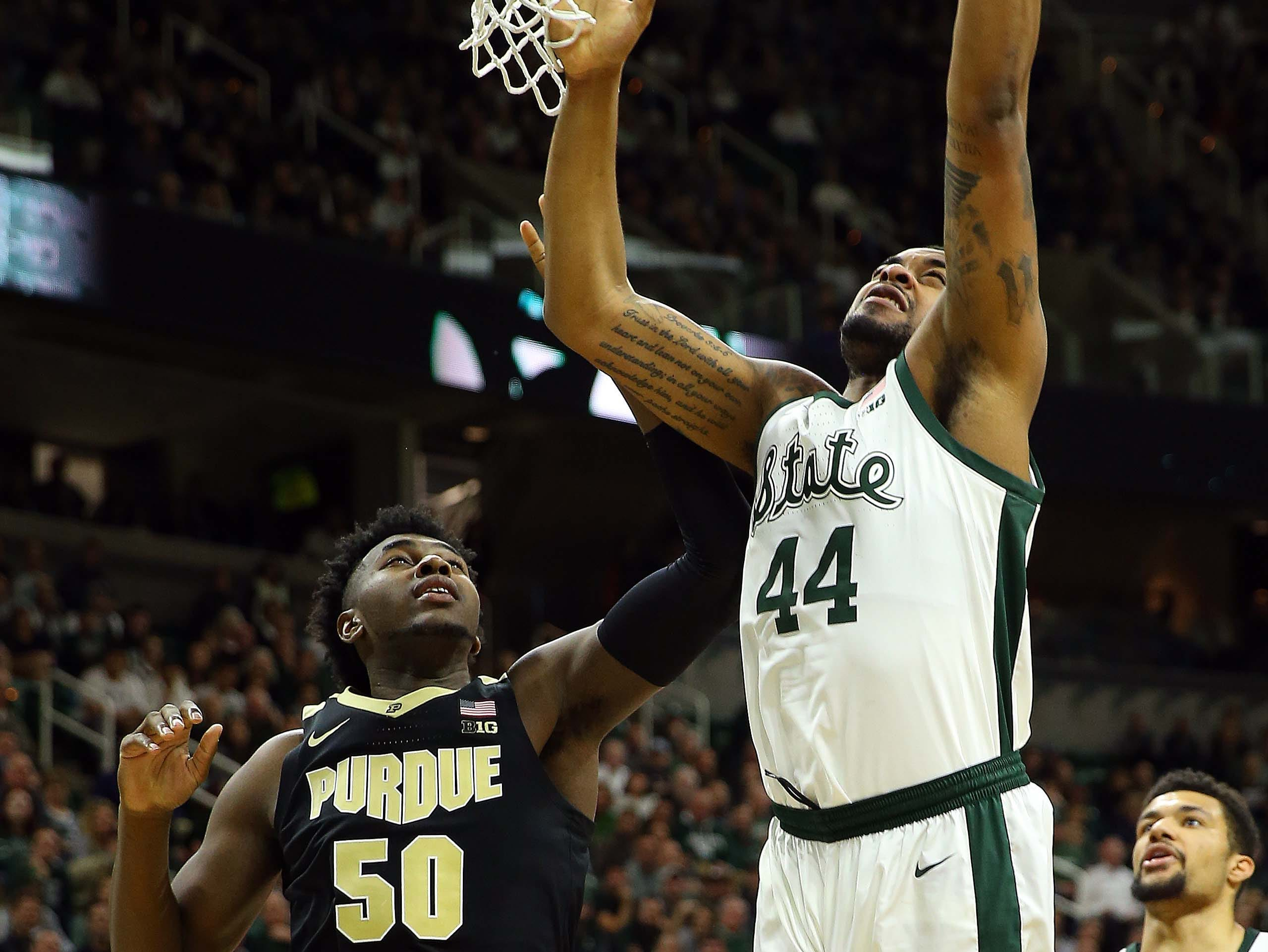 Jan 8, 2019; East Lansing, MI, USA; Michigan State Spartans forward Nick Ward (44) is defended by Purdue Boilermakers forward Trevion Williams (50) during the second half of a game at the Breslin Center. Mandatory Credit: Mike Carter-USA TODAY Sports