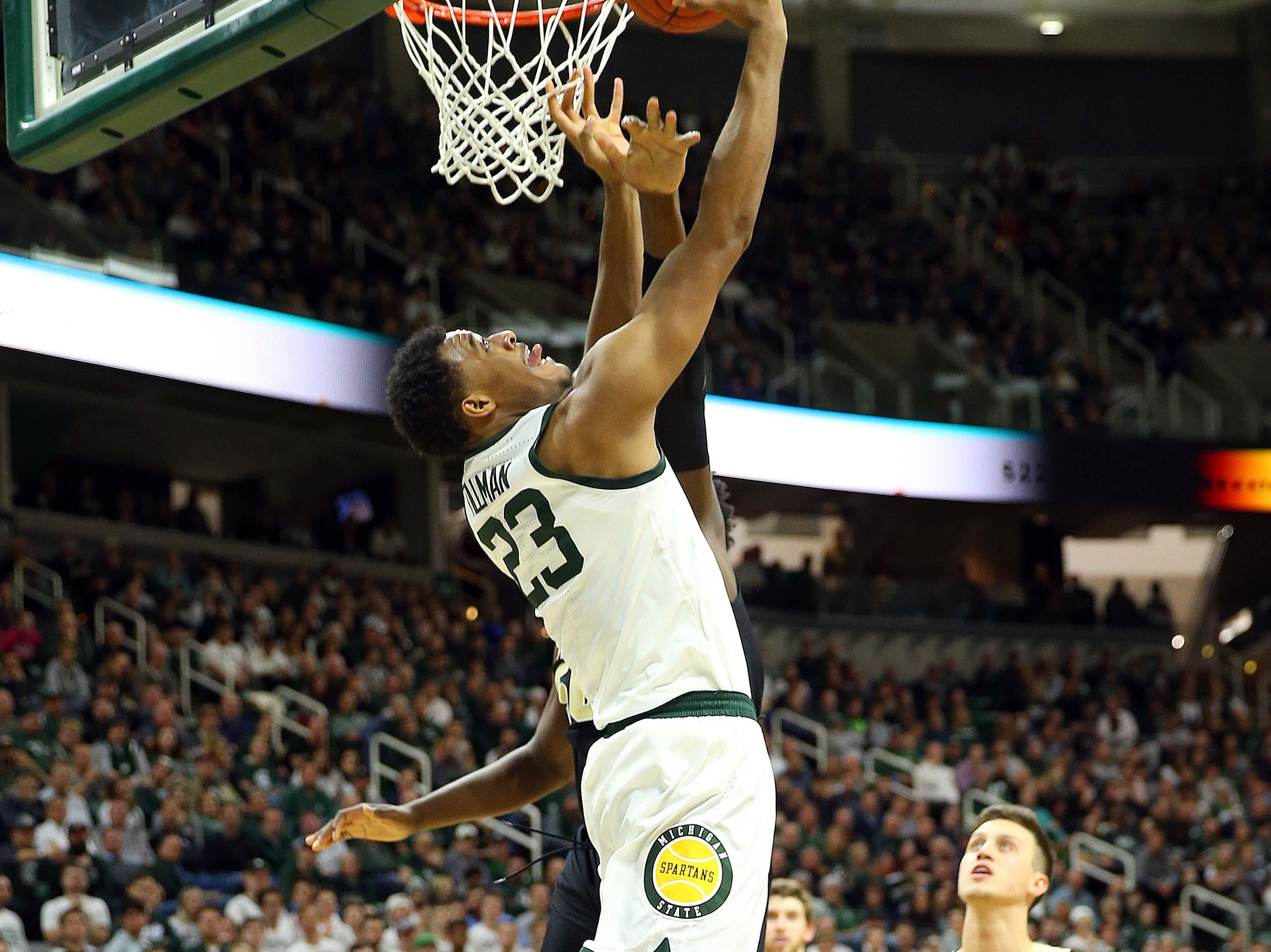 Jan 8, 2019; East Lansing, MI, USA; Michigan State Spartans forward Xavier Tillman (23) lays the ball up against the Purdue Boilermakers during the first half of a game at the Breslin Center. Mandatory Credit: Mike Carter-USA TODAY Sports
