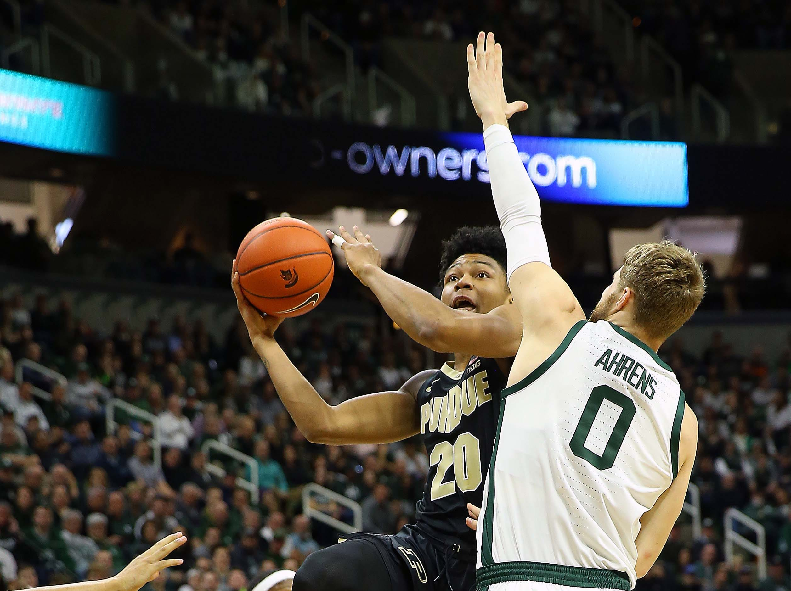 Jan 8, 2019; East Lansing, MI, USA; Purdue Boilermakers guard Nojel Eastern (20) drive the lane against Michigan State Spartans forward Kyle Ahrens (0) during the first half of a game at the Breslin Center. Mandatory Credit: Mike Carter-USA TODAY Sports