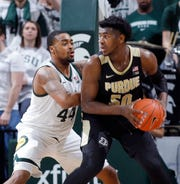 Purdue's Trevion Williams, right, works for a shot against Michigan State's Nick Ward during the second half Tuesday night.