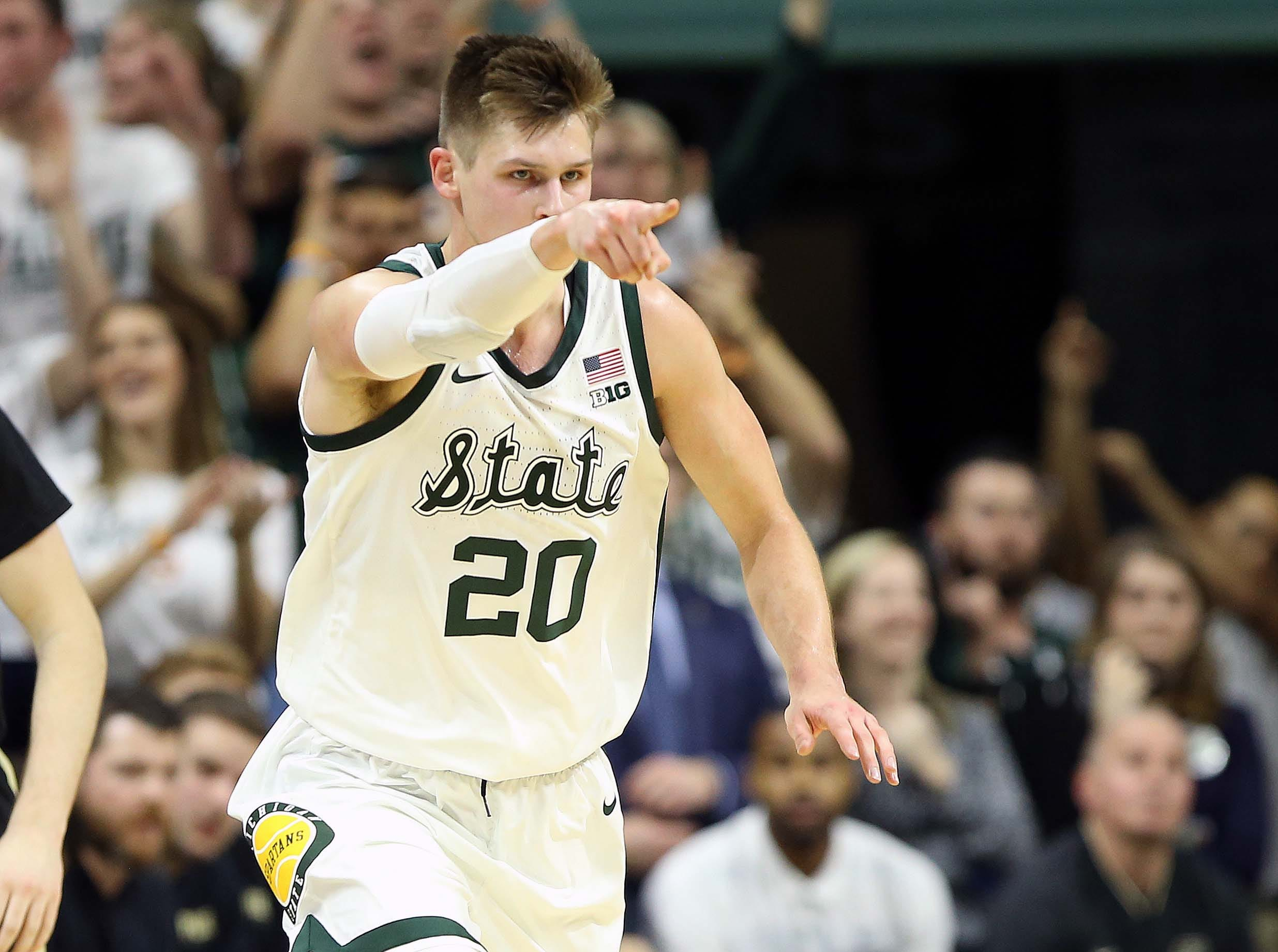 Jan 8, 2019; East Lansing, MI, USA; Michigan State Spartans guard Matt McQuaid (20) reacts during the first half of a game against the Purdue Boilermakers at the Breslin Center. Mandatory Credit: Mike Carter-USA TODAY Sports