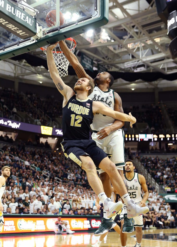 Jan 8, 2019; East Lansing, MI, USA; Purdue Boilermakers forward Evan Boudreaux (12) lays the ball up in front of Michigan State Spartans forward Nick Ward (44) during the first half of a game at the Breslin Center. Mandatory Credit: Mike Carter-USA TODAY Sports