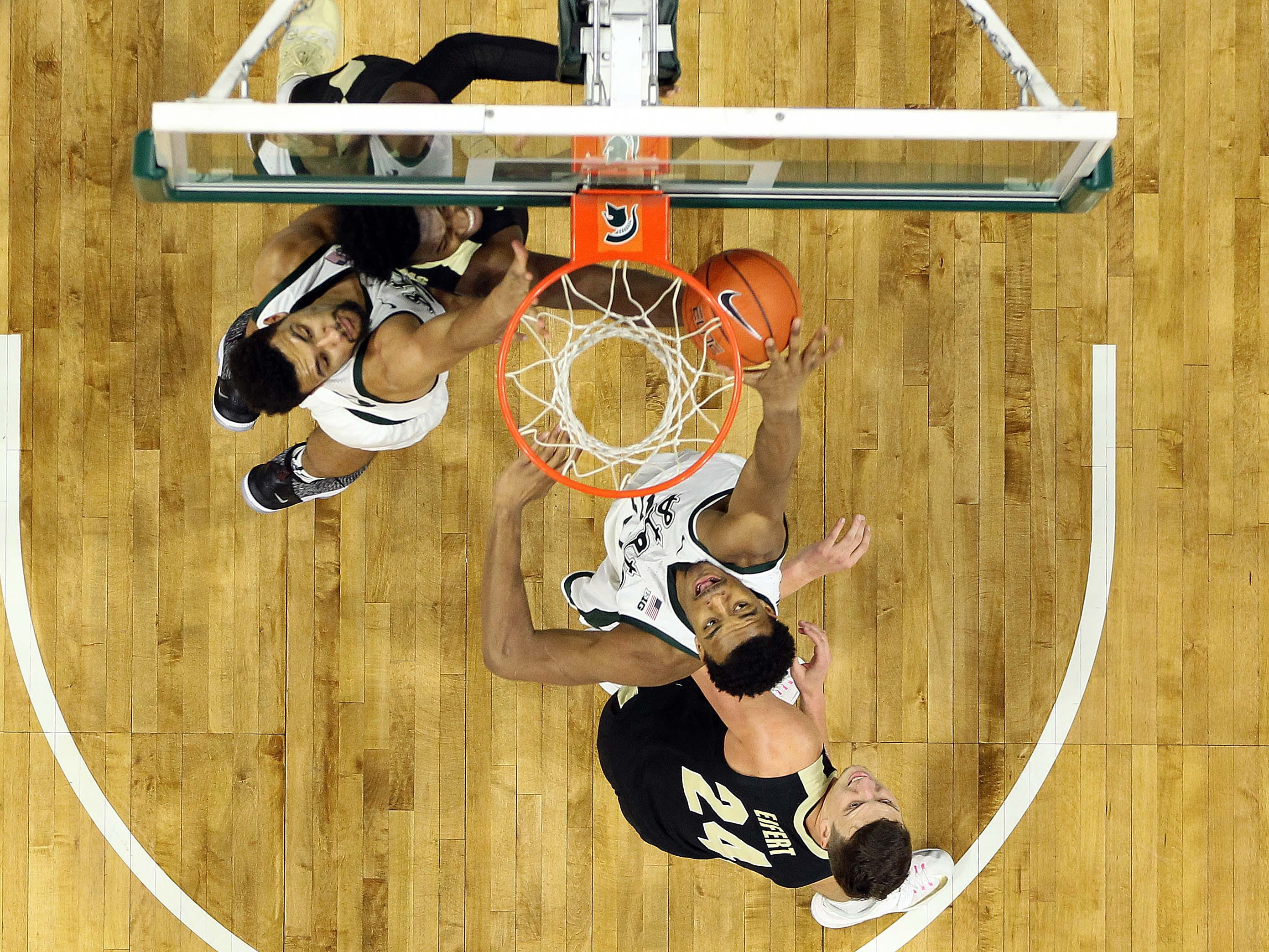 Jan 8, 2019; East Lansing, MI, USA; Michigan State Spartans forward Xavier Tillman (23) blocks the shot of Purdue Boilermakers forward Trevion Williams (50) during the second half of a game at the Breslin Center. Mandatory Credit: Mike Carter-USA TODAY Sports
