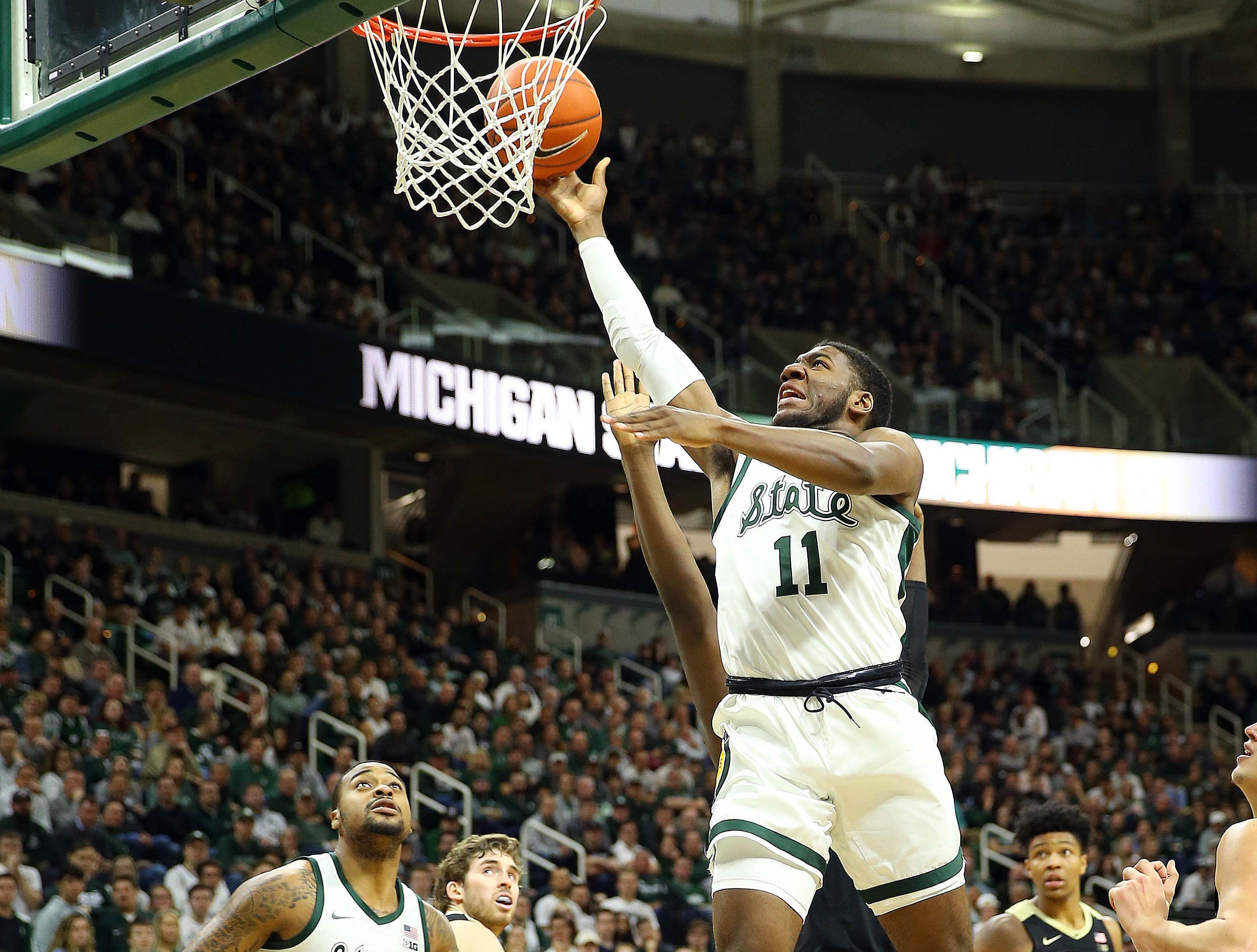 Jan 8, 2019; East Lansing, MI, USA; Michigan State Spartans forward Aaron Henry (11) lays the ball up during the second half of a game against the Purdue Boilermakers at the Breslin Center. Mandatory Credit: Mike Carter-USA TODAY Sports