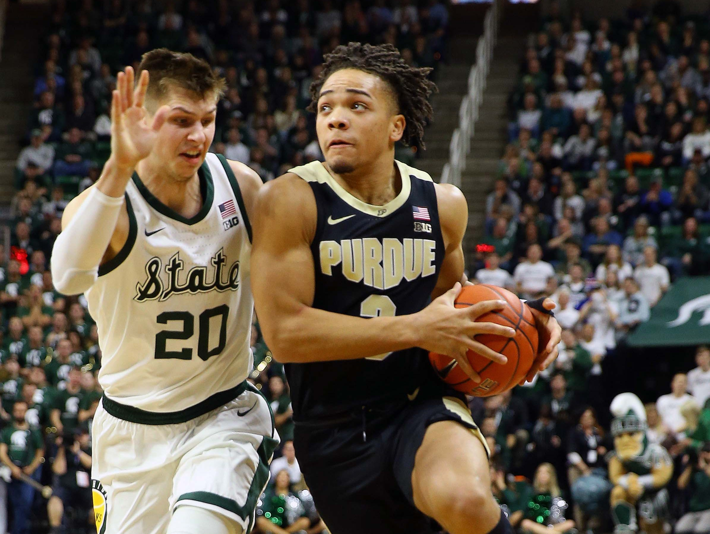 Jan 8, 2019; East Lansing, MI, USA; Purdue Boilermakers guard Carsen Edwards (3) is defended by Michigan State Spartans guard Matt McQuaid (20) during the first half of a game at the Breslin Center. Mandatory Credit: Mike Carter-USA TODAY Sports