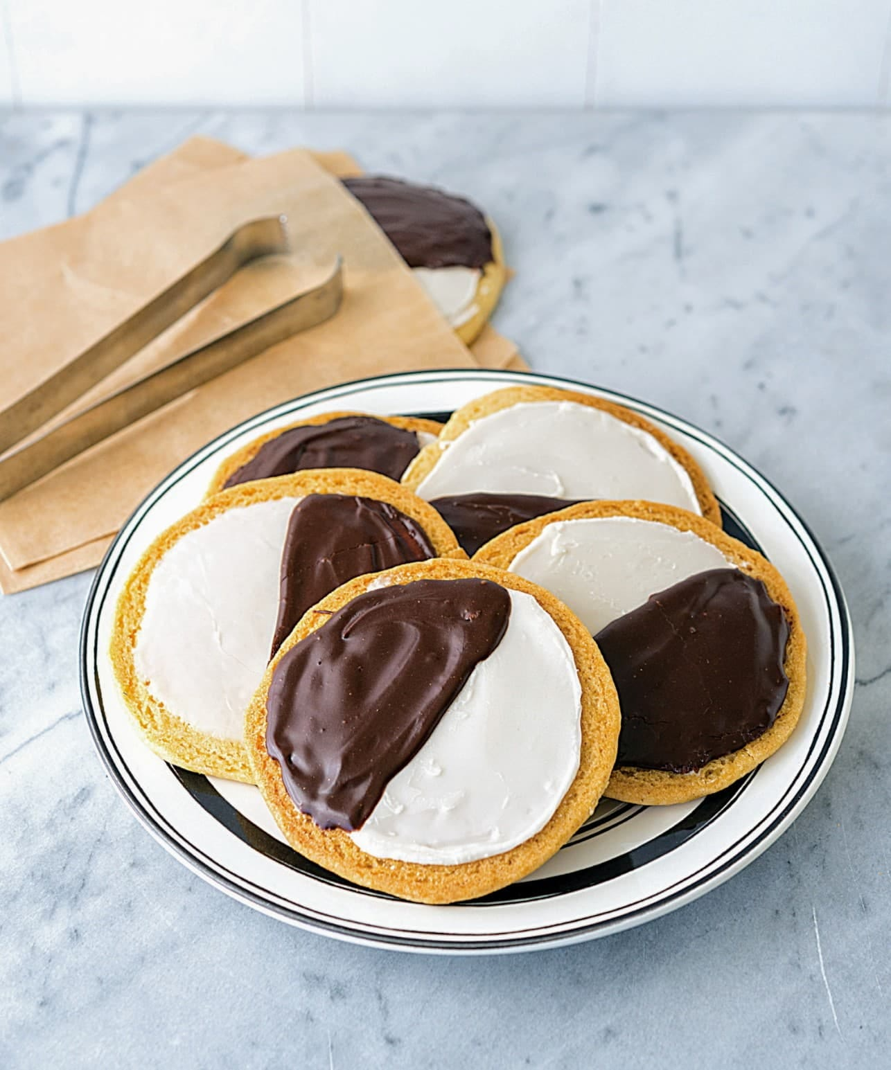 Black and White cookies are a hit among New York City vegans. Photo is from Vegan NYC by Michael Suchman and Ethan Ciment.