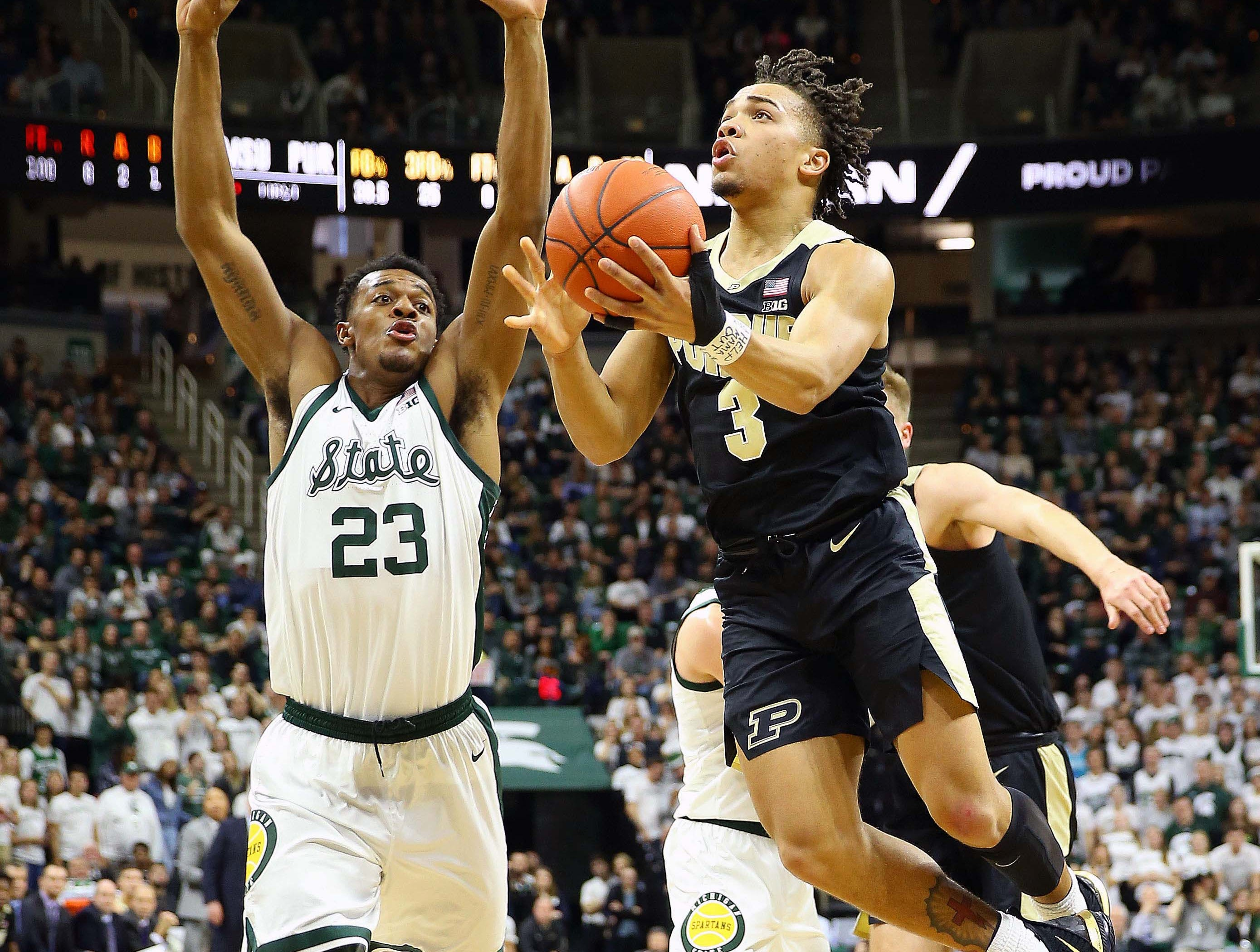 Jan 8, 2019; East Lansing, MI, USA; Purdue Boilermakers guard Carsen Edwards (3) drives the lane in front of Michigan State Spartans forward Xavier Tillman (23) during the first half of a game at the Breslin Center. Mandatory Credit: Mike Carter-USA TODAY Sports