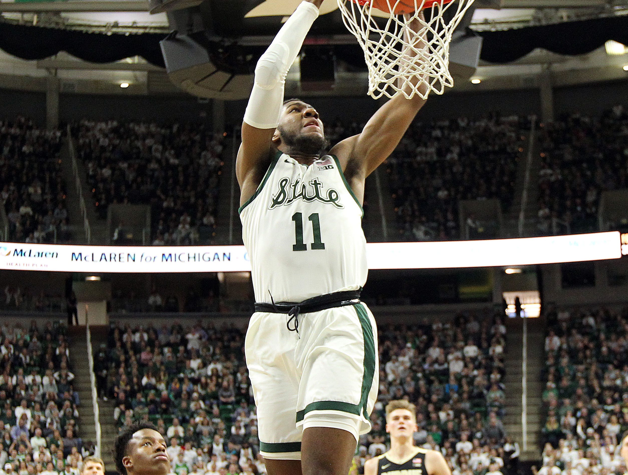 Jan 8, 2019; East Lansing, MI, USA; Michigan State Spartans forward Aaron Henry (11) dunks the ball during the first half against the Purdue Boilermakers at the Breslin Center. Mandatory Credit: Mike Carter-USA TODAY Sports