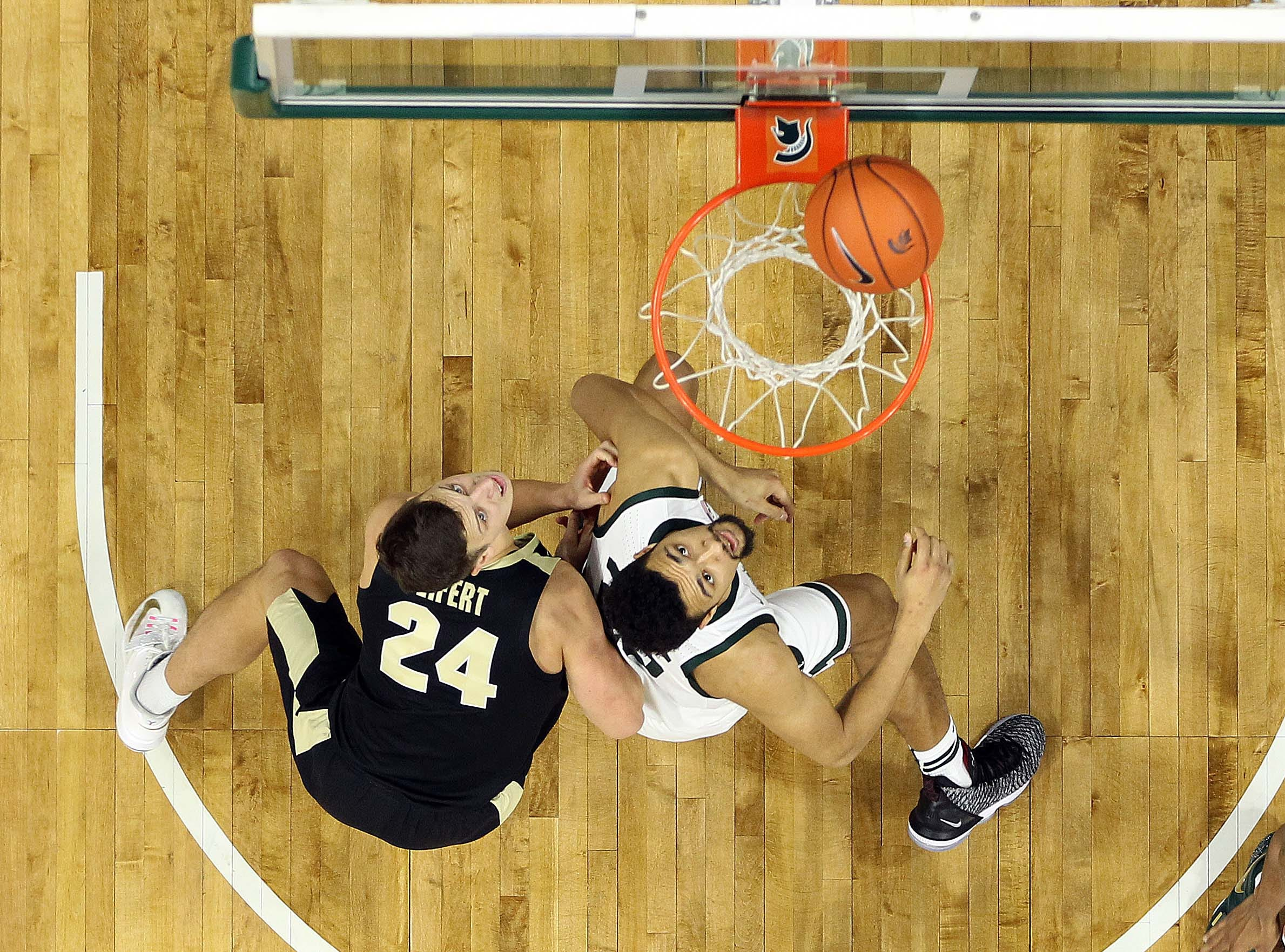Jan 8, 2019; East Lansing, MI, USA; Michigan State Spartans forward Kenny Goins (25) and Purdue Boilermakers forward Grady Eifert (24) fight for position during the second half of a game at the Breslin Center. Mandatory Credit: Mike Carter-USA TODAY Sports