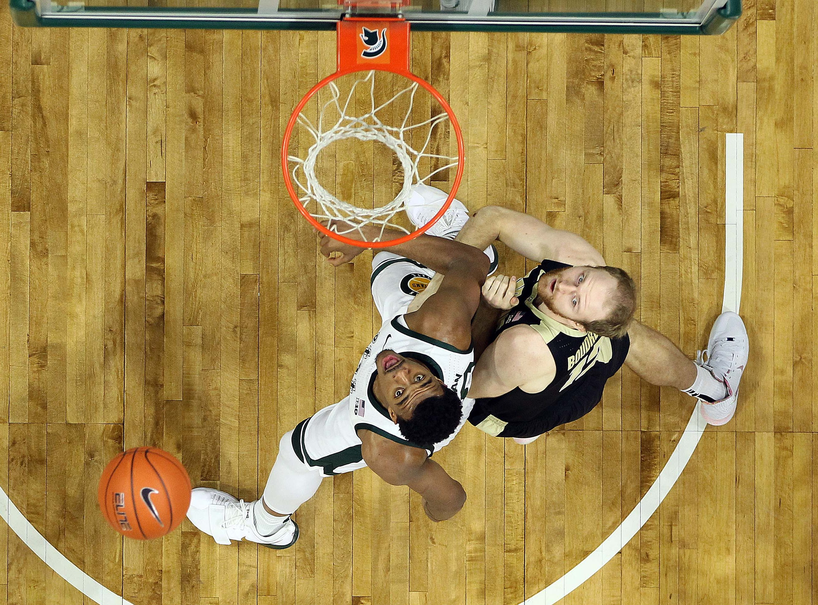 Jan 8, 2019; East Lansing, MI, USA; Michigan State Spartans forward Xavier Tillman (23) and Purdue Boilermakers forward Grady Eifert (24) fight for position during the first half of a game at the Breslin Center. Mandatory Credit: Mike Carter-USA TODAY Sports