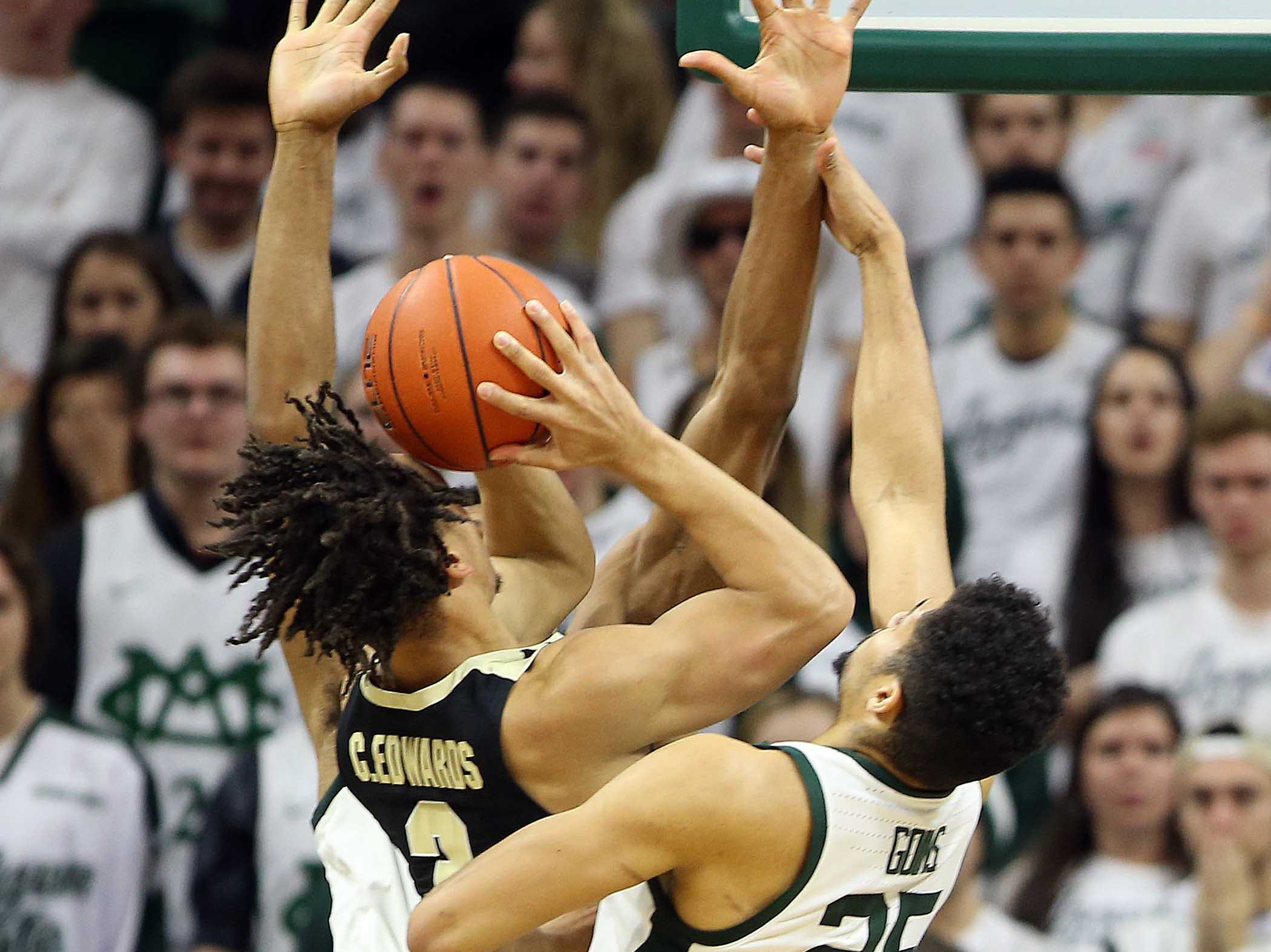 Jan 8, 2019; East Lansing, MI, USA; Purdue Boilermakers guard Carsen Edwards (3) is defended by Michigan State Spartans forward Kenny Goins (25) and Michigan State Spartans forward Xavier Tillman (23) during the second half of a game at the Breslin Center. Mandatory Credit: Mike Carter-USA TODAY Sports
