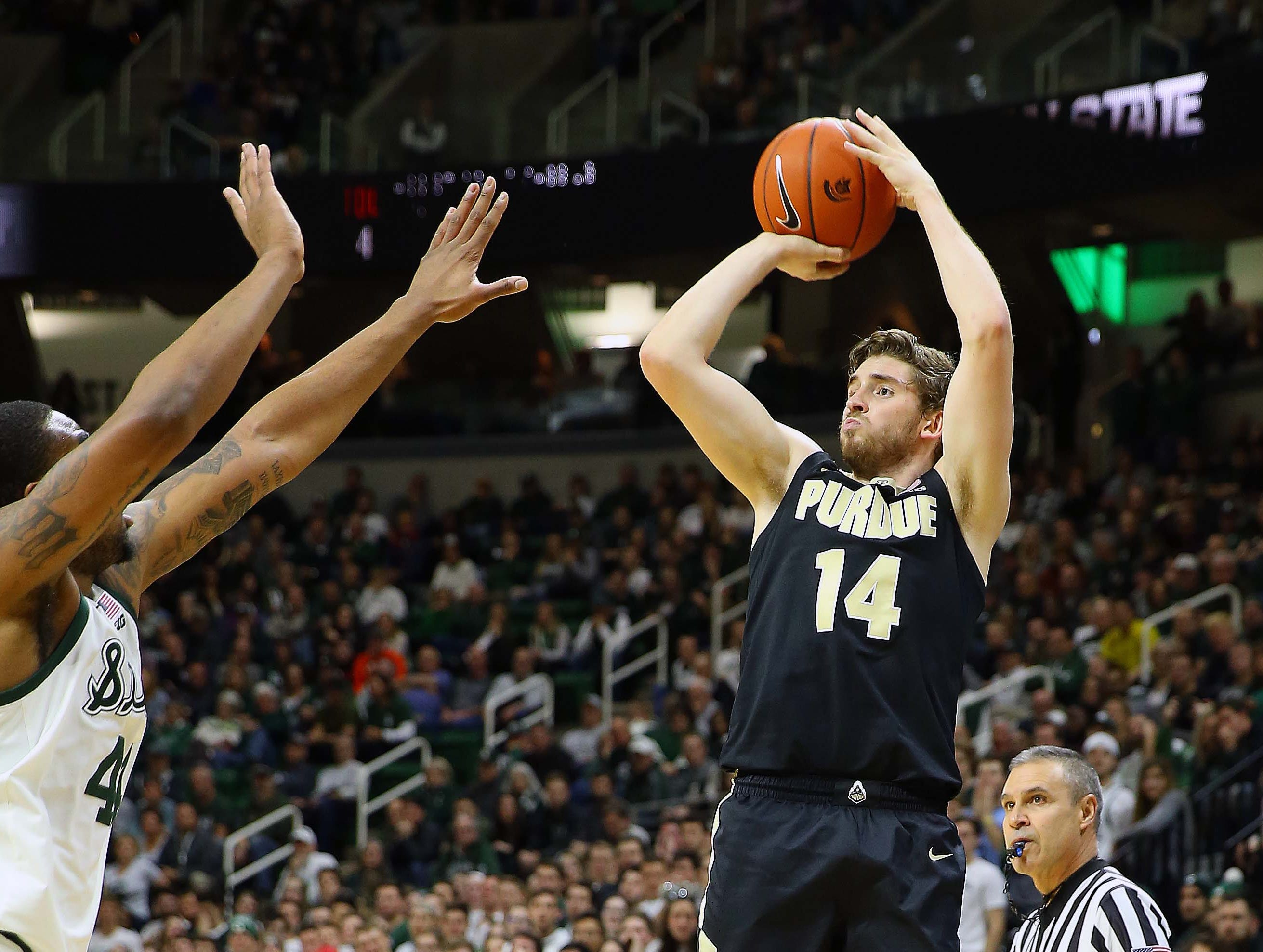 Jan 8, 2019; East Lansing, MI, USA; Purdue Boilermakers guard Ryan Cline (14) attempts a three point basket during the first half of a game against the Michigan State Spartans at the Breslin Center. Mandatory Credit: Mike Carter-USA TODAY Sports