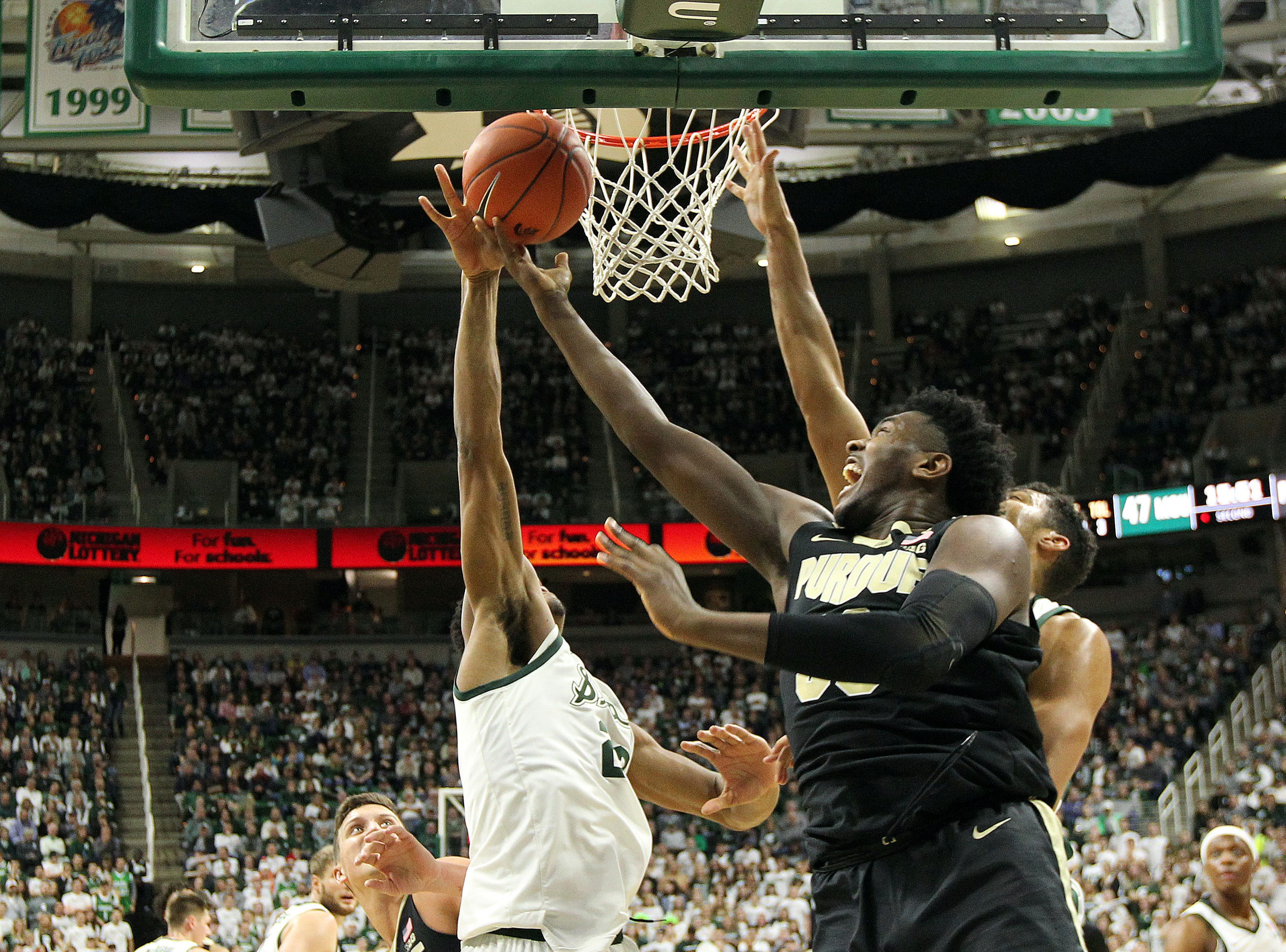 Jan 8, 2019; East Lansing, MI, USA; Purdue Boilermakers forward Trevion Williams (50) shoots against Michigan State Spartans forward Kenny Goins (25) during the second half at the Breslin Center. Mandatory Credit: Mike Carter-USA TODAY Sports