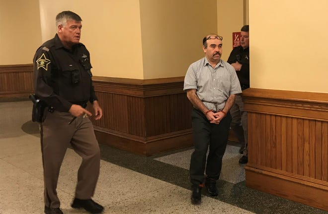Franco Navarrete is led out of Tippecanoe County Courthouse Wednesday afternoon. Navarrete is charged with two counts of murder for the Aug. 10, 2017, killings on Eastwich Drive in Lafayette.