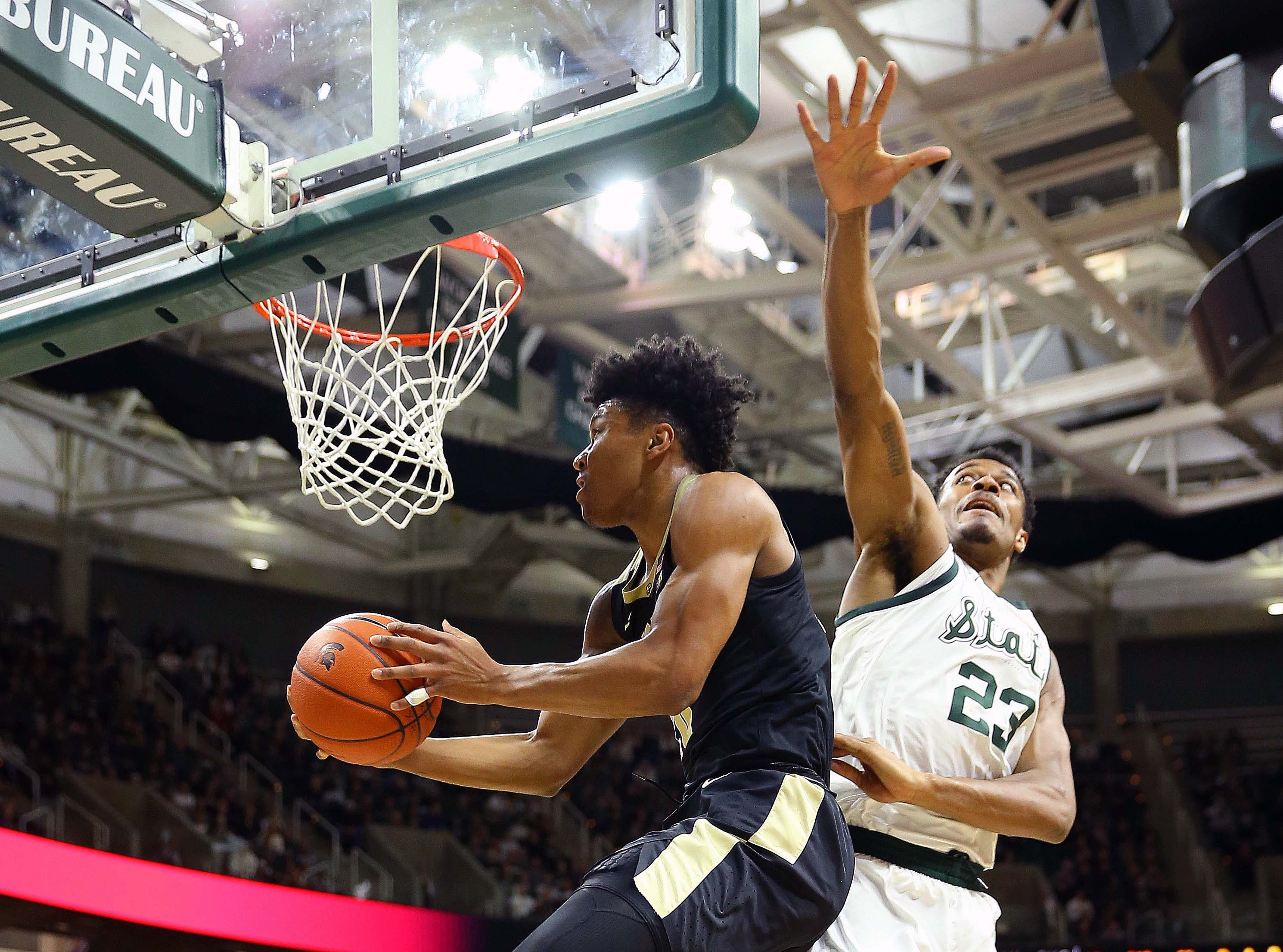 Jan 8, 2019; East Lansing, MI, USA; Purdue Boilermakers guard Eric Hunter Jr. (2) lays the ball up in front of Michigan State Spartans forward Xavier Tillman (23) during the first half of a game at the Breslin Center. Mandatory Credit: Mike Carter-USA TODAY Sports