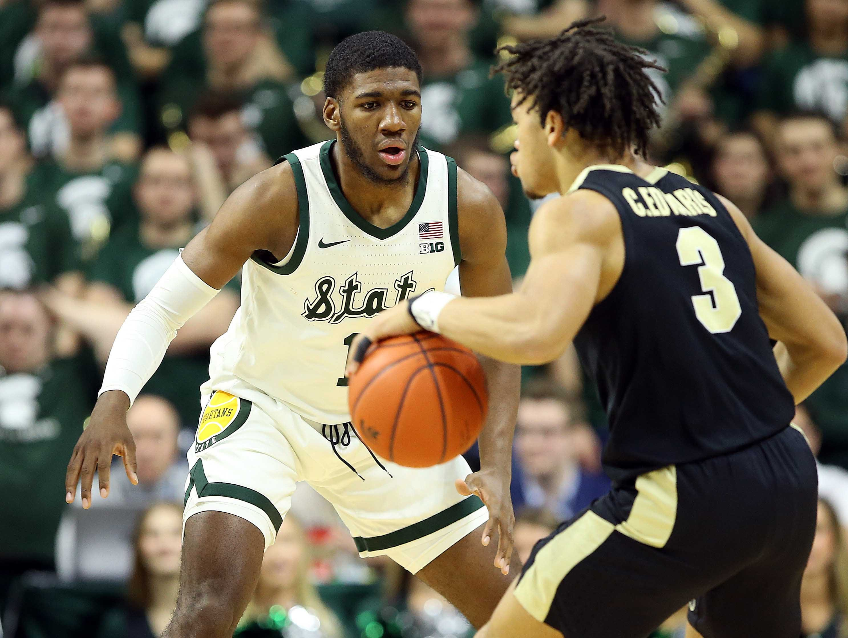Jan 8, 2019; East Lansing, MI, USA; Purdue Boilermakers guard Carsen Edwards (3) is defended by Michigan State Spartans forward Aaron Henry (11) during the first half of a game at the Breslin Center. Mandatory Credit: Mike Carter-USA TODAY Sports