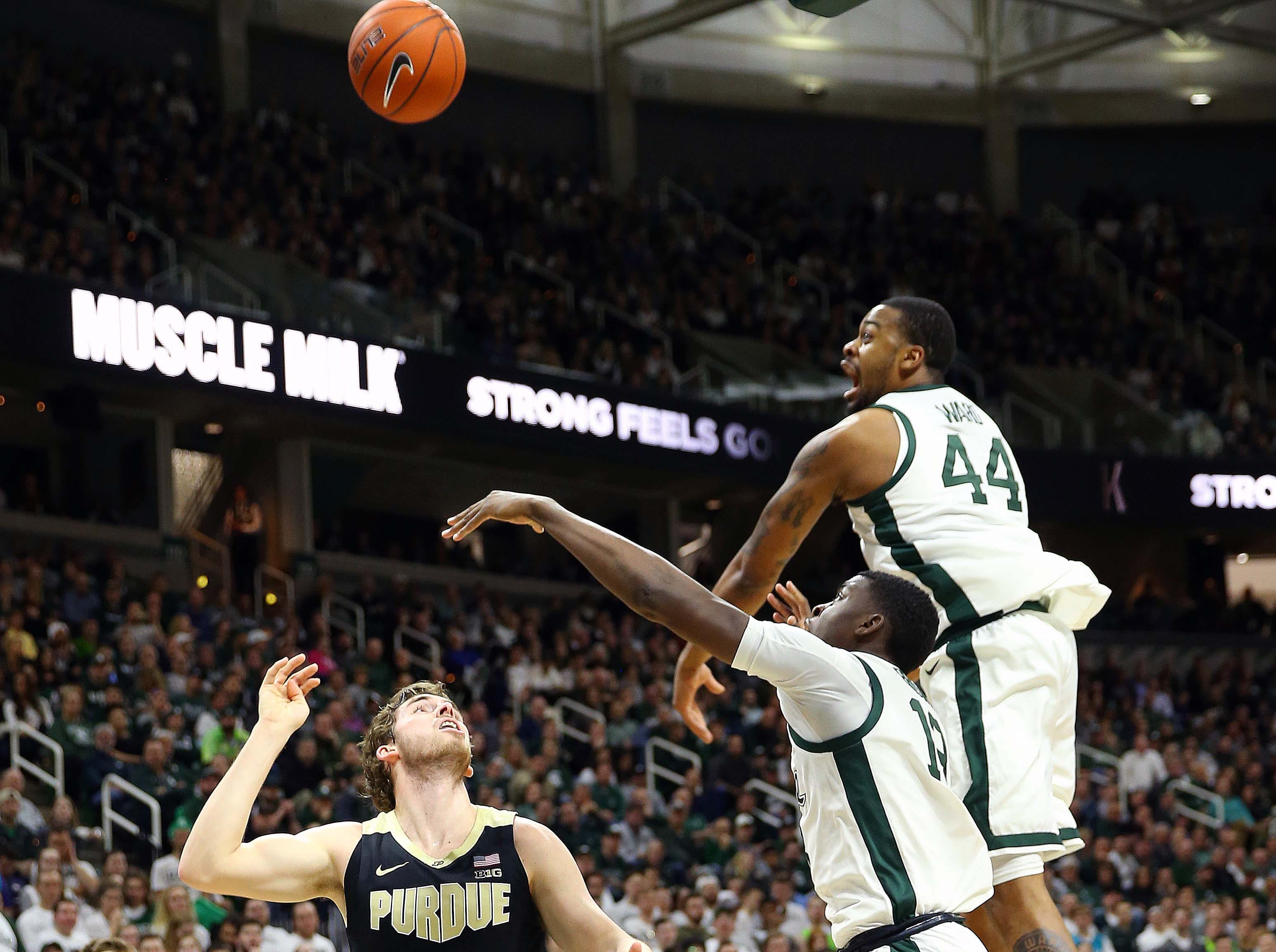 Jan 8, 2019; East Lansing, MI, USA; Purdue Boilermakers guard Ryan Cline (14) has his shot blocked by Michigan State Spartans forward Nick Ward (44) during the first half of a game at the Breslin Center. Mandatory Credit: Mike Carter-USA TODAY Sports