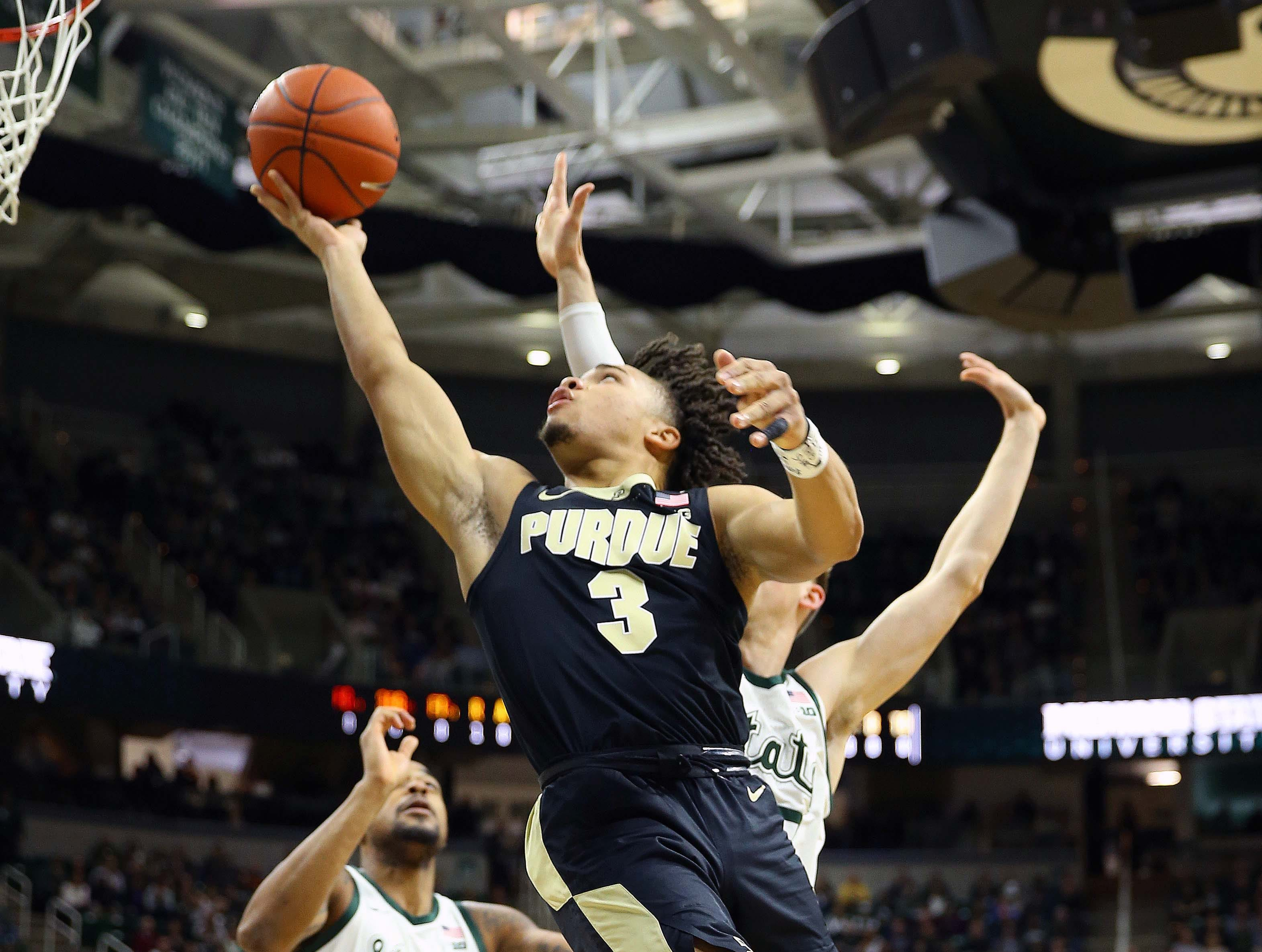 Jan 8, 2019; East Lansing, MI, USA; Purdue Boilermakers guard Carsen Edwards (3) lays the ball up in front of Michigan State Spartans guard Matt McQuaid (20) during the first half of a game at the Breslin Center. Mandatory Credit: Mike Carter-USA TODAY Sports
