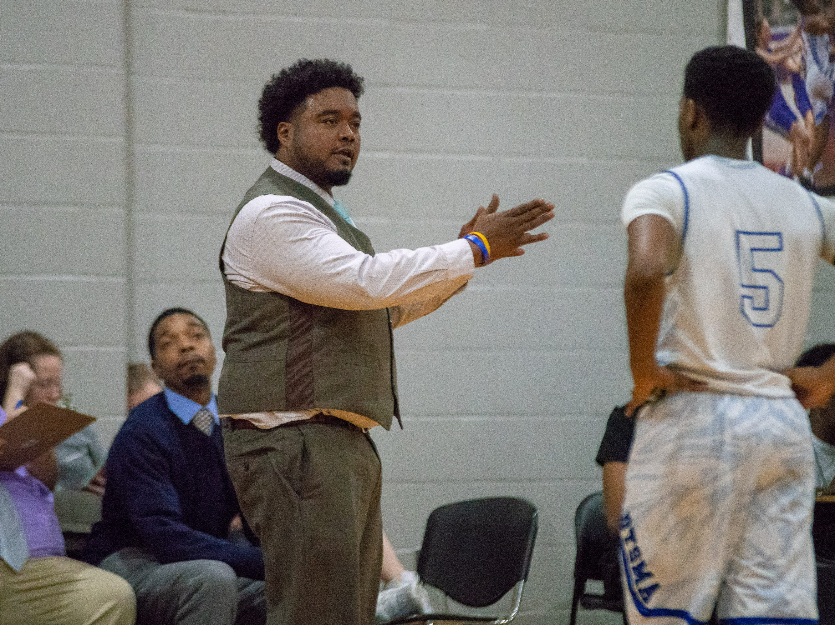 David Thibodaux's head coach Vincent Hicks coaching from the sidelines as the Acadiana high school Rams take on the David Thibodaux Bulldogs on January 8, 2019.