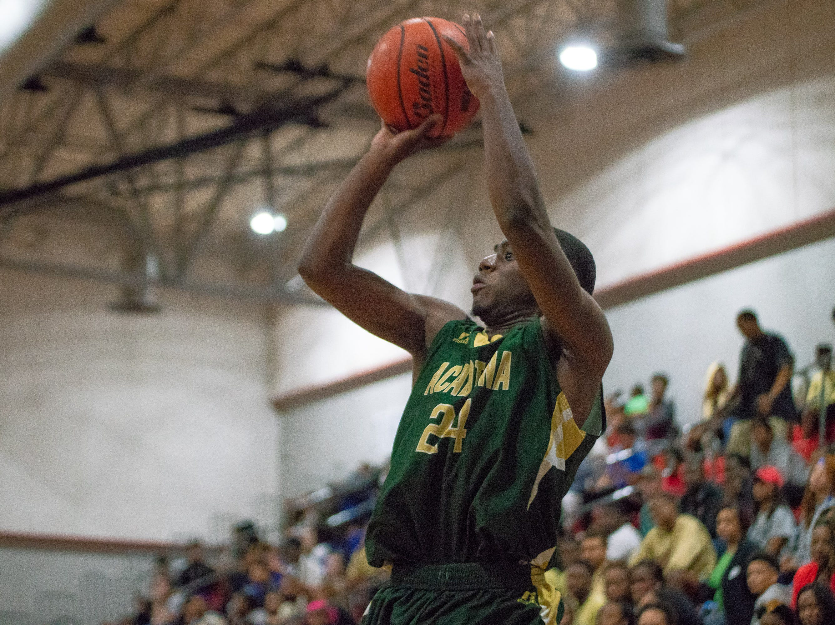 Acadiana's Phillip Thibodeaux shoots to score as the Acadiana high school Rams take on the David Thibodaux Bulldogs on January 8, 2019.